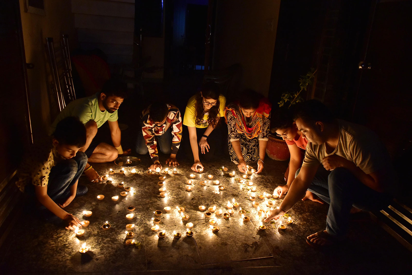 People light candles during the vigil in Amritsar, India.