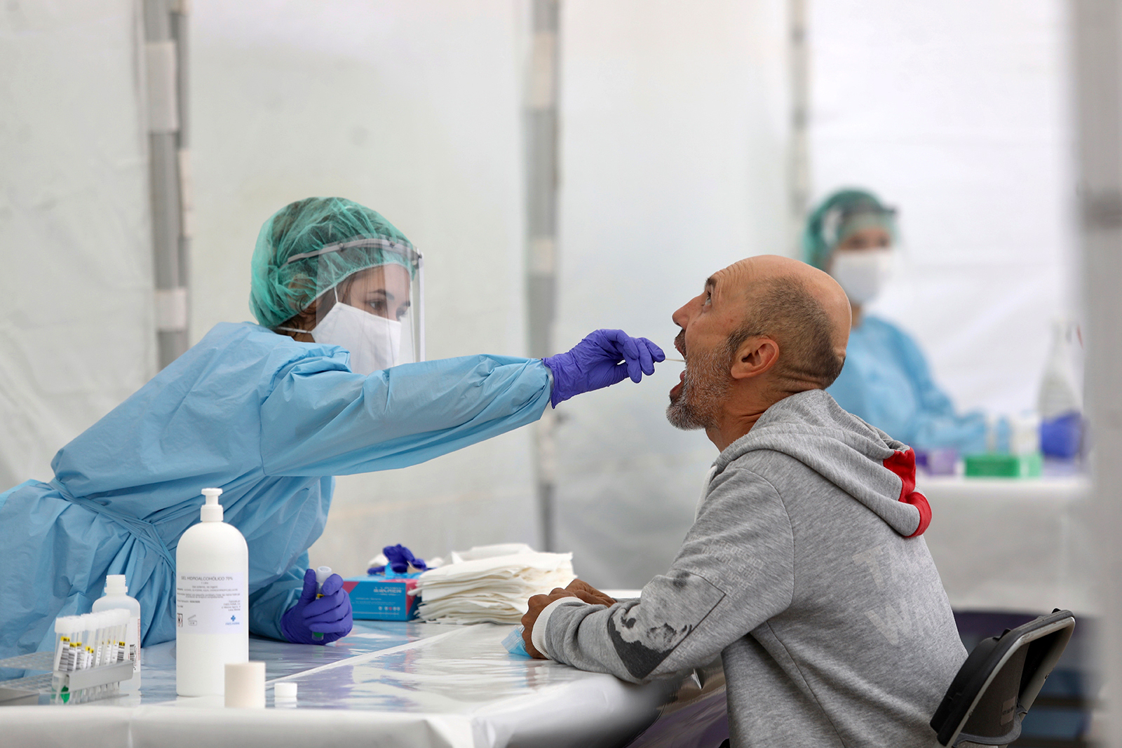A health worker performs an oral smear on a resident of Ordizia, Spain on July 6.