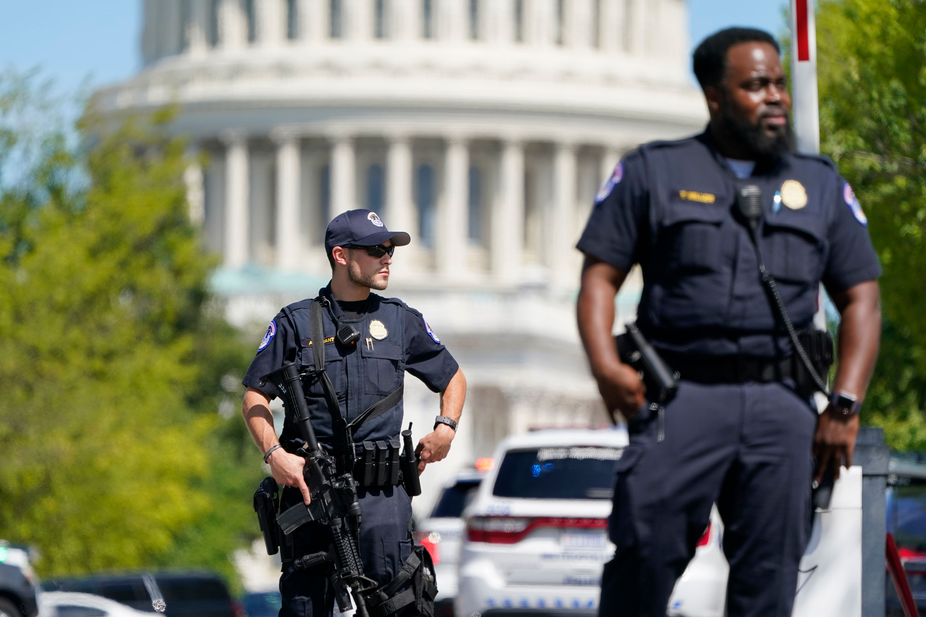 US Capitol Police officers stand at an intersection near the Capitol on August 19.