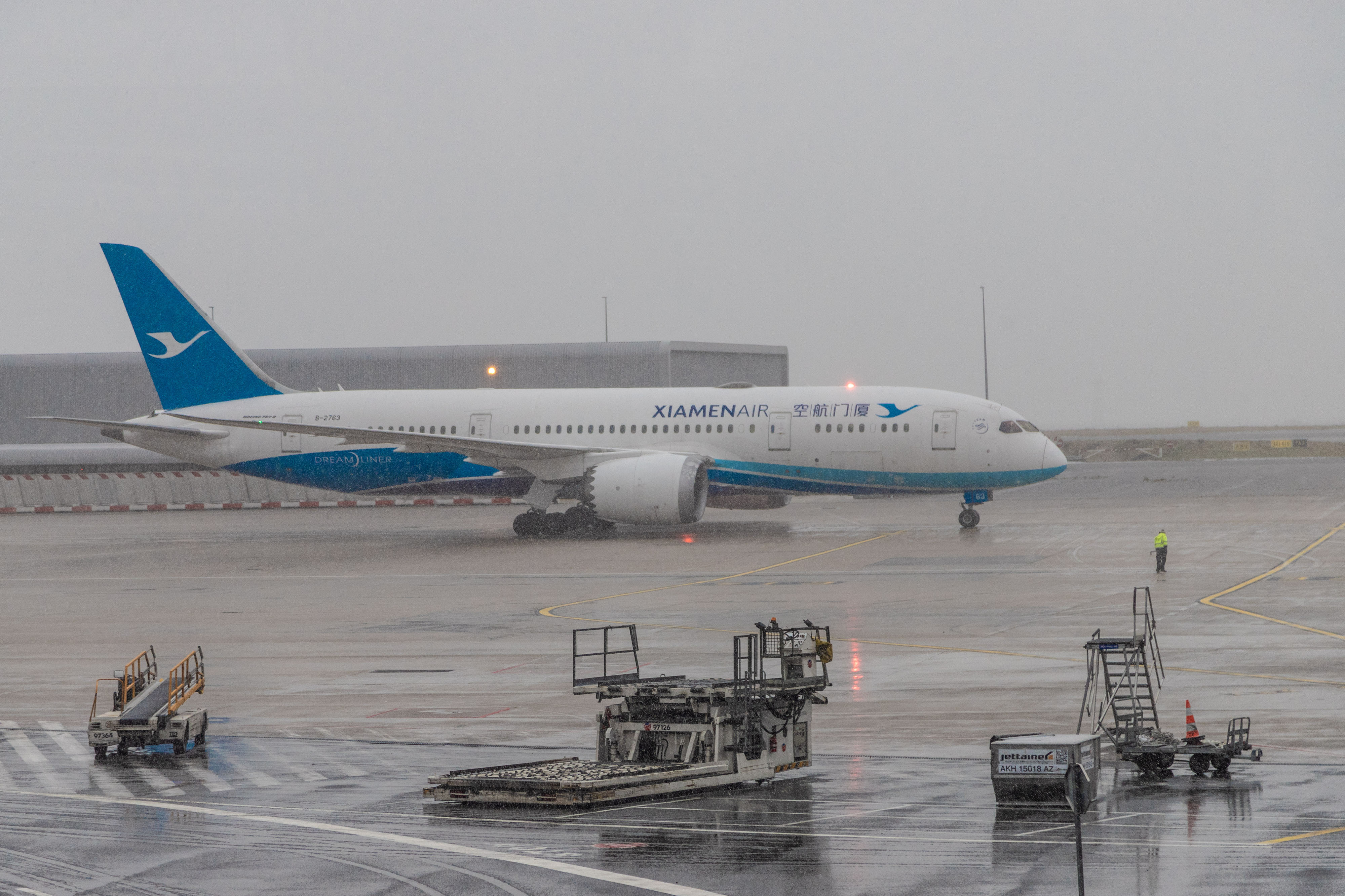 A passenger aircraft operated by Xiamen Airlines sits on the tarmac at Charles de Gaulle airport, in Roissy, France, on Tuesday, January 28.