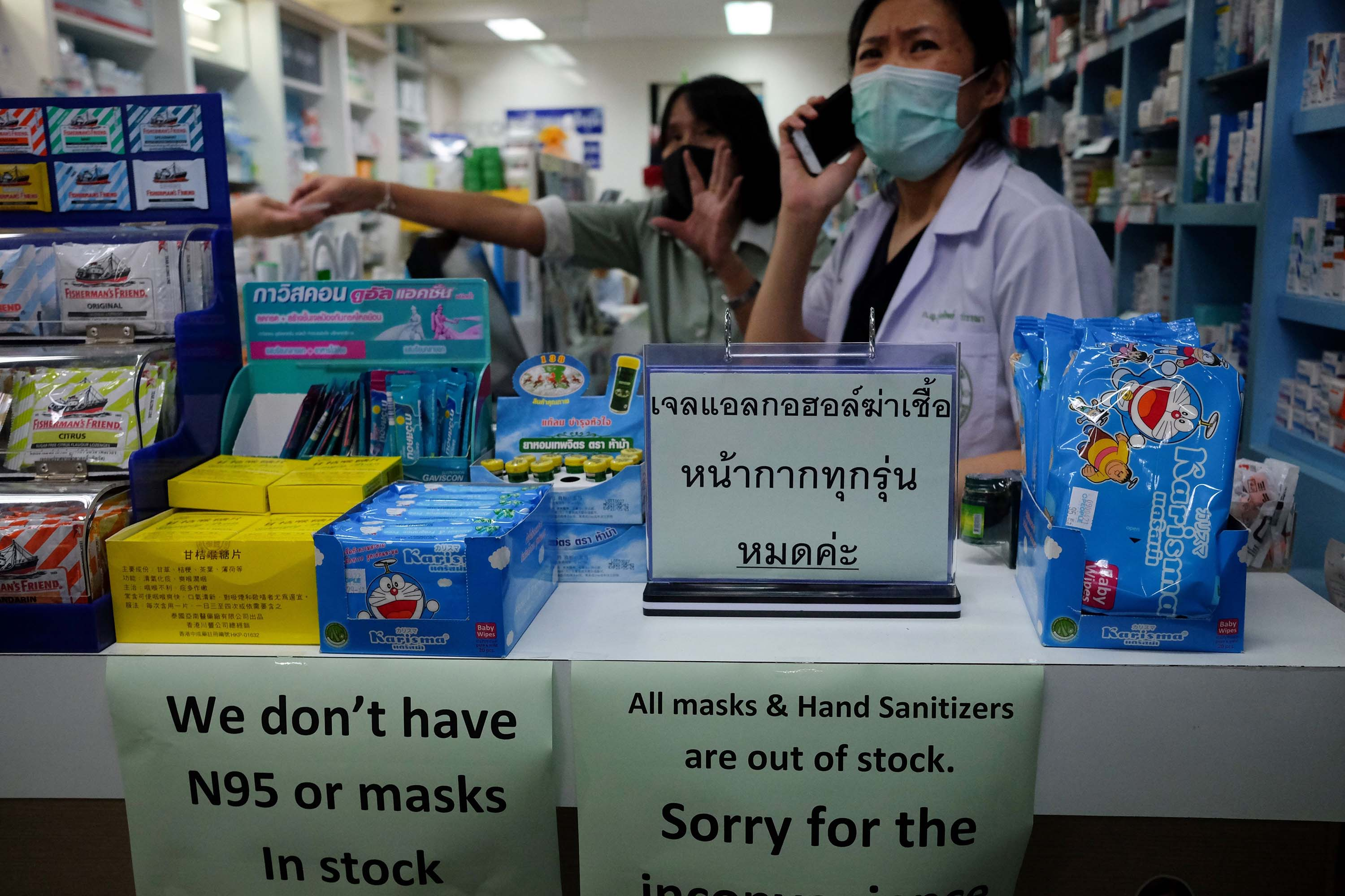 A sign at a pharmacy in Bangkok, Thailand, notifies customers that face masks are out of stock, on January 31.