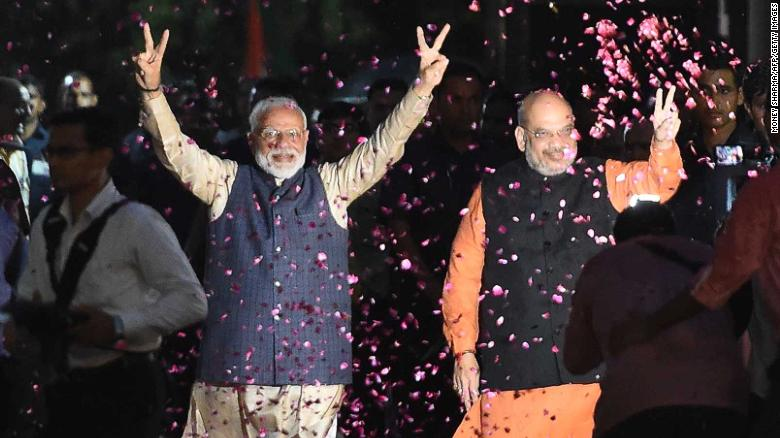 Indian Prime Minister Narendra Modi and BJP President Amit Shah celebrate the BJP's election win.