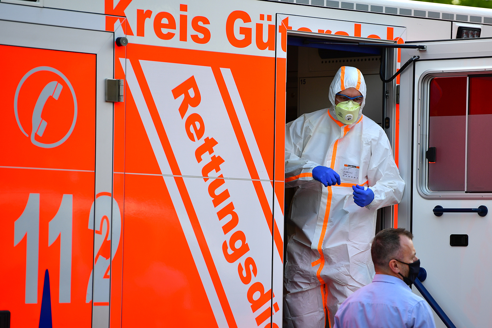 A paramedic wearing full body protection stands inside an ambulance on June 20, in Verl, near Guetersloh, Germany.