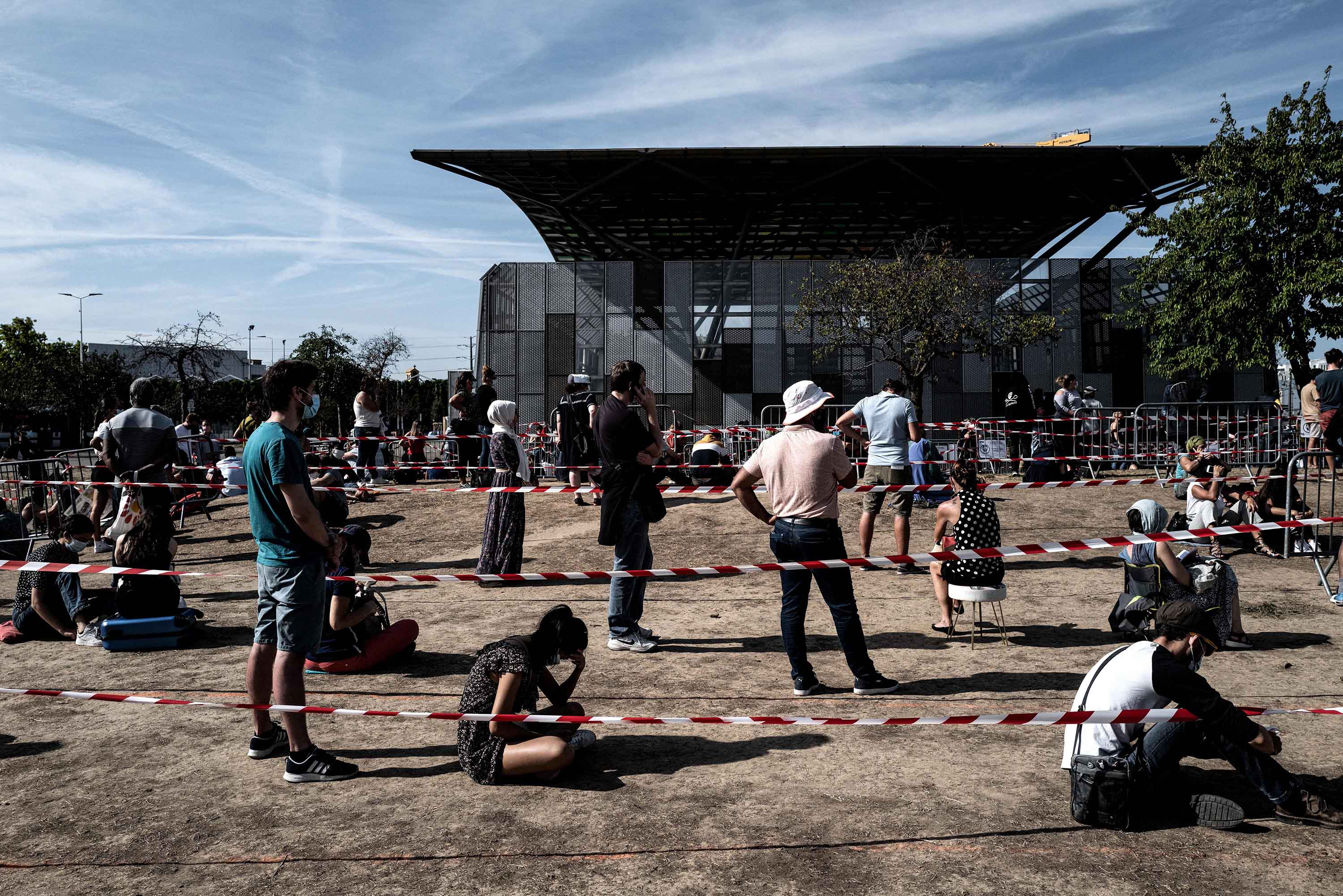 People queue to get tested for Covid-19 in Venissieux, France, on September 11.