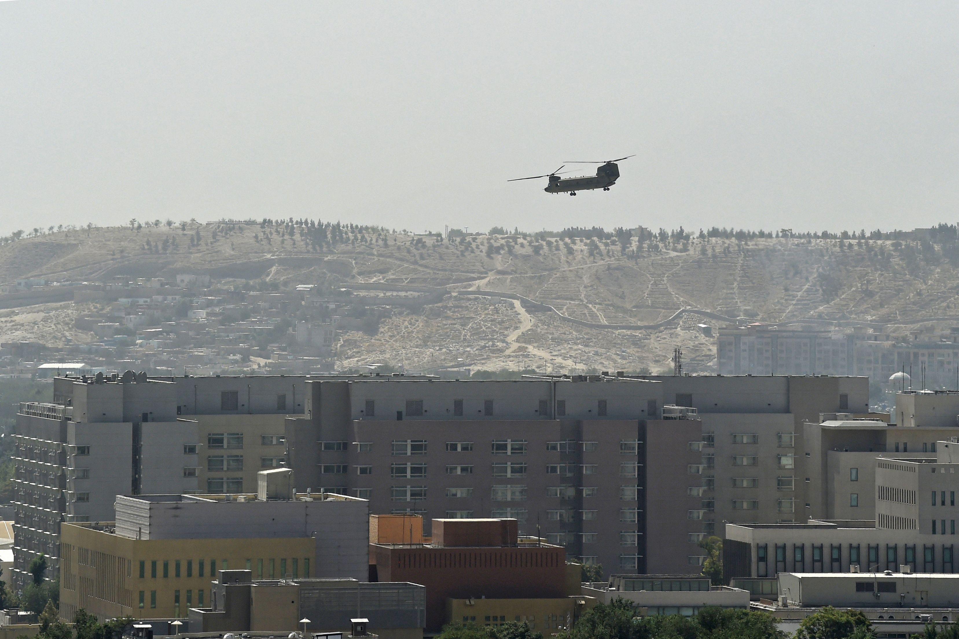 A US military helicopter is pictured flying above the US embassy in Kabul on Sunday.