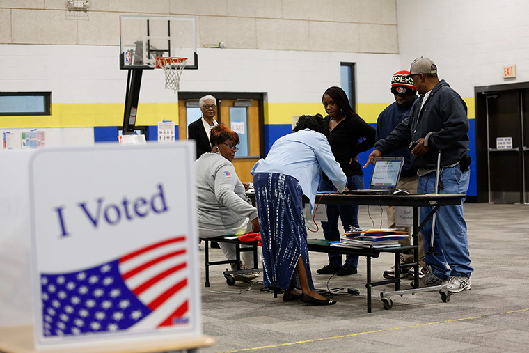 Voters check-in with poll workers at Mary Ford Elementary School in North Charleston, South Carolina, on Saturday, February 29.