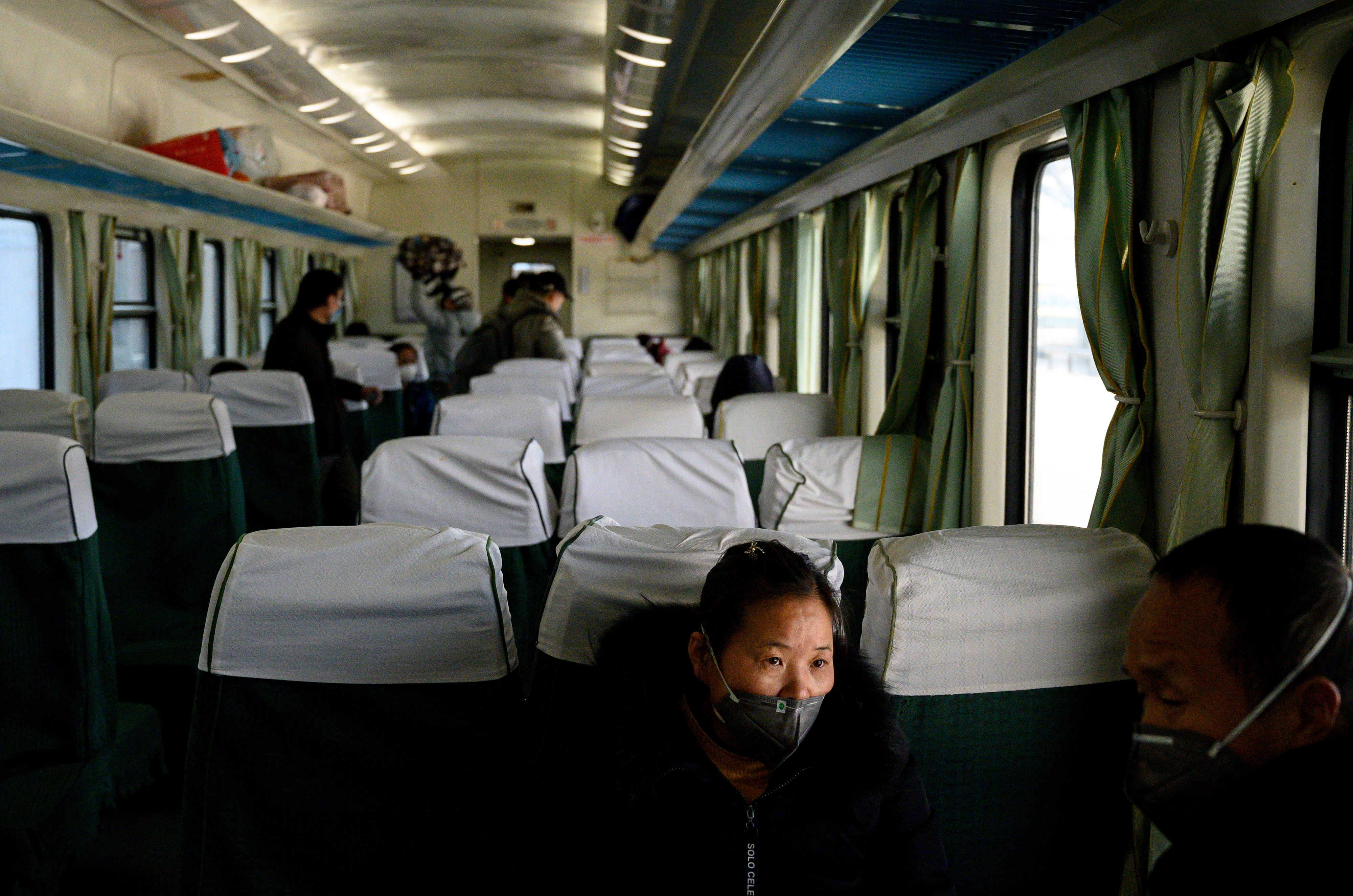 Passengers on a train at the Shanghai South railway station on February 9, 2020.