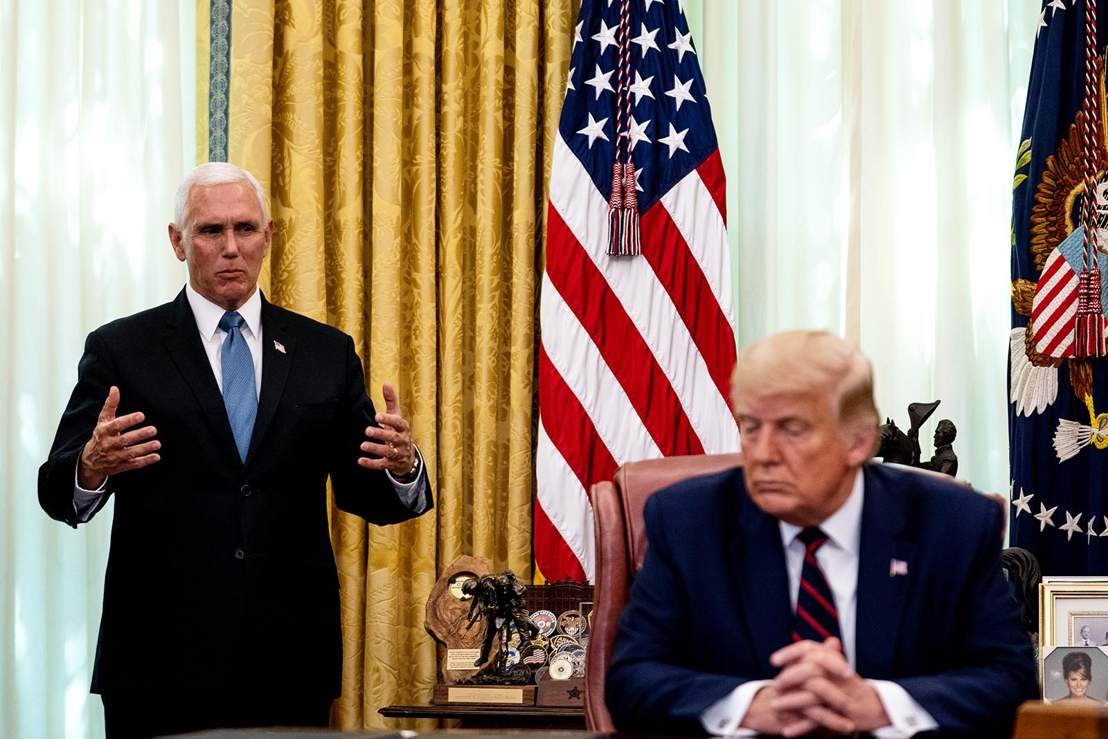 Vice President Mike Pence speaks as President Donald Trump participates in a signing ceremony and meeting with the President of Serbia Aleksandar Vucic and the Prime Minister of Kosovo Avdullah Hoti in the Oval Office of the White House on September 4 in Washington.