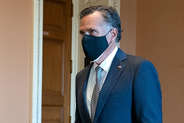 Sen. Mitt Romney walks to the Senate floor on Capitol Hill on Tuesday, October 20, in Washington, DC.