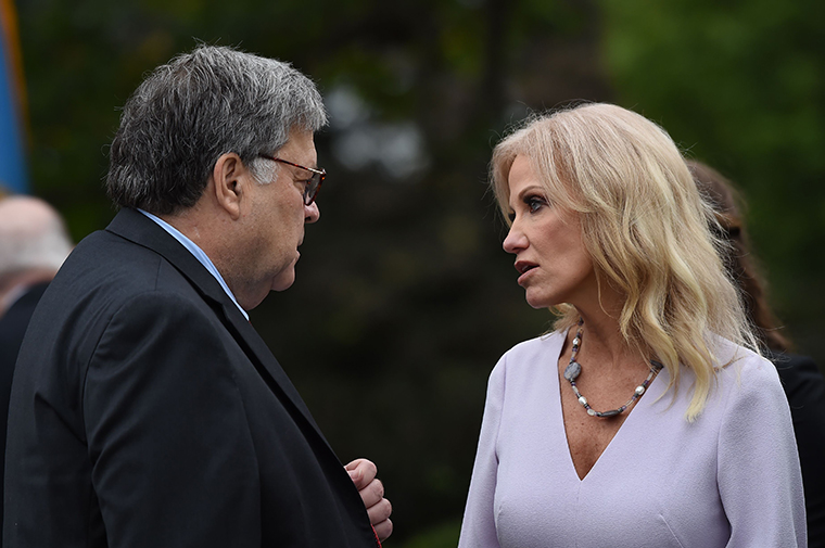 US Attorney General William Barr speaks with Assistant to the President and Senior Counselor to the President Kellyanne Conway at the ceremony where US President Donald Trump nominated Judge Amy Coney Barrett to the nominated to the US Supreme Court, in the Rose Garden of the White House in Washington, DC, on September 26, 2020.