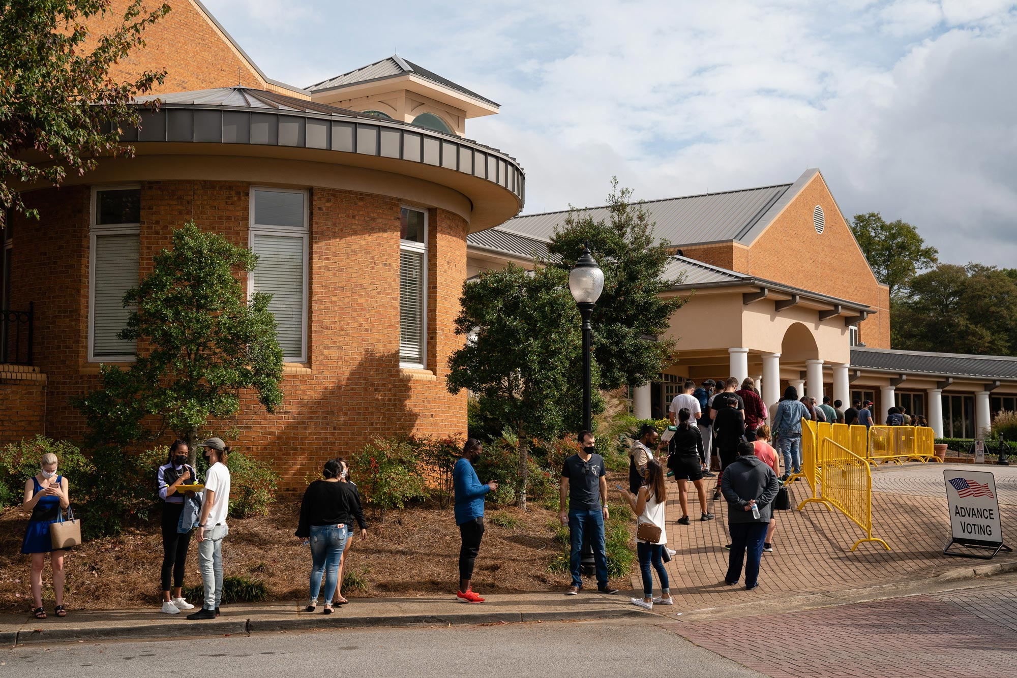 People wait in line to cast their ballots at Smyrna Community Center on October 24 in Smyrna, Georgia.