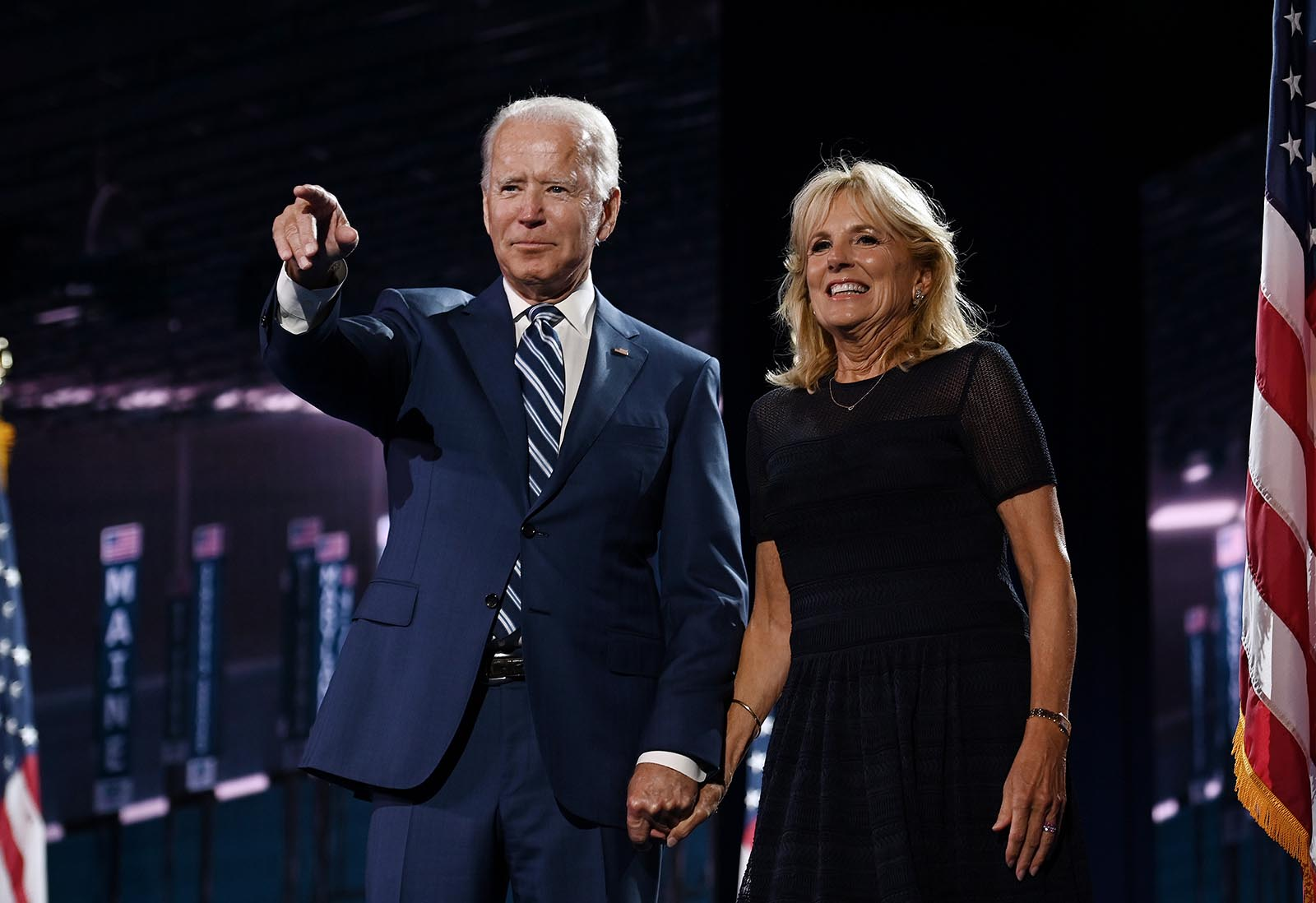 Former Vice President Joe Biden and former Second Lady Jill Biden stand on stage at the end of the third day of the Democratic National Convention at the Chase Center in Wilmington, Delaware on August 19.