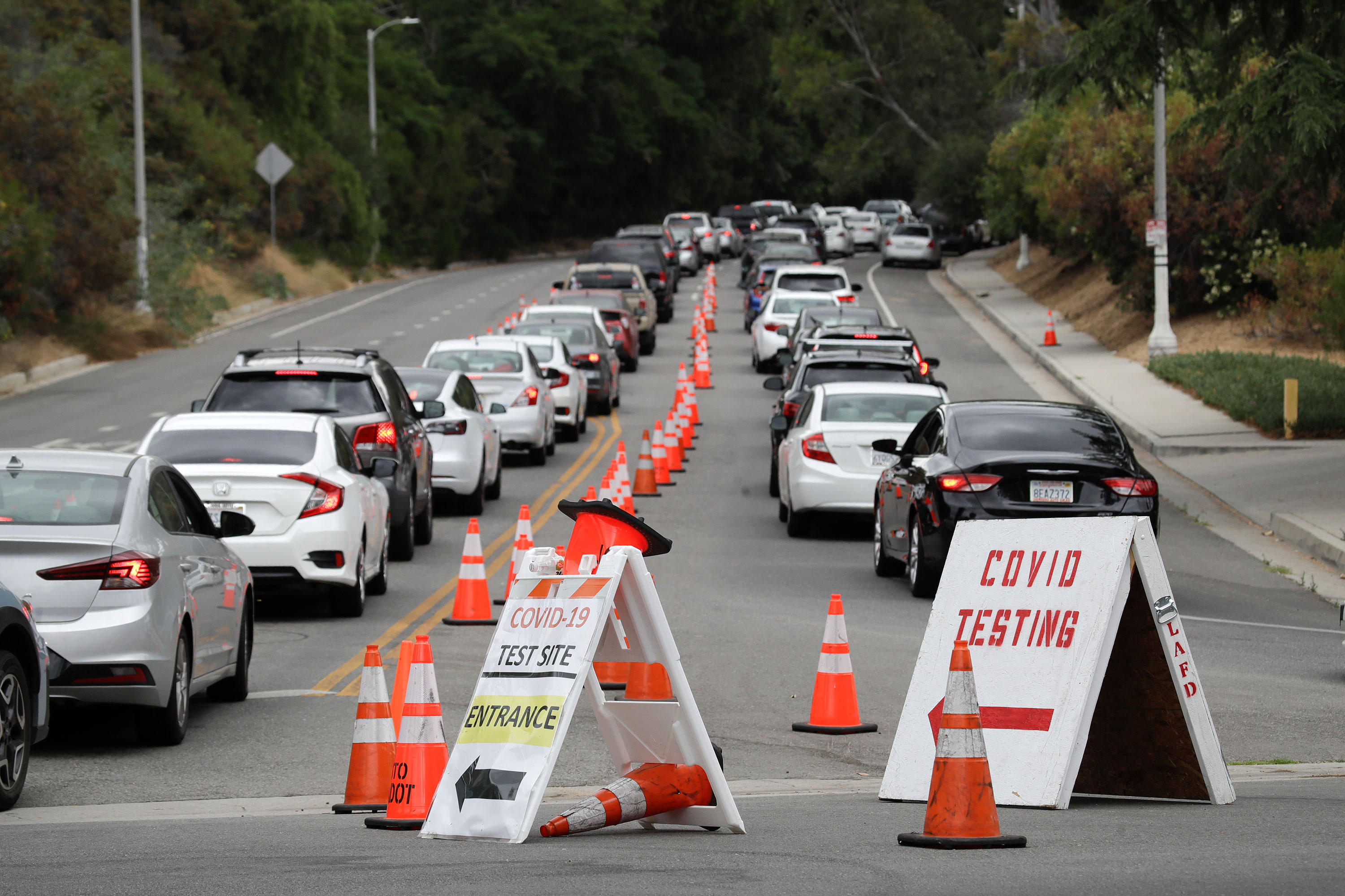 Motorists line up at a coronavirus testing site at Dodger Stadium on June 29 in Los Angeles, California.