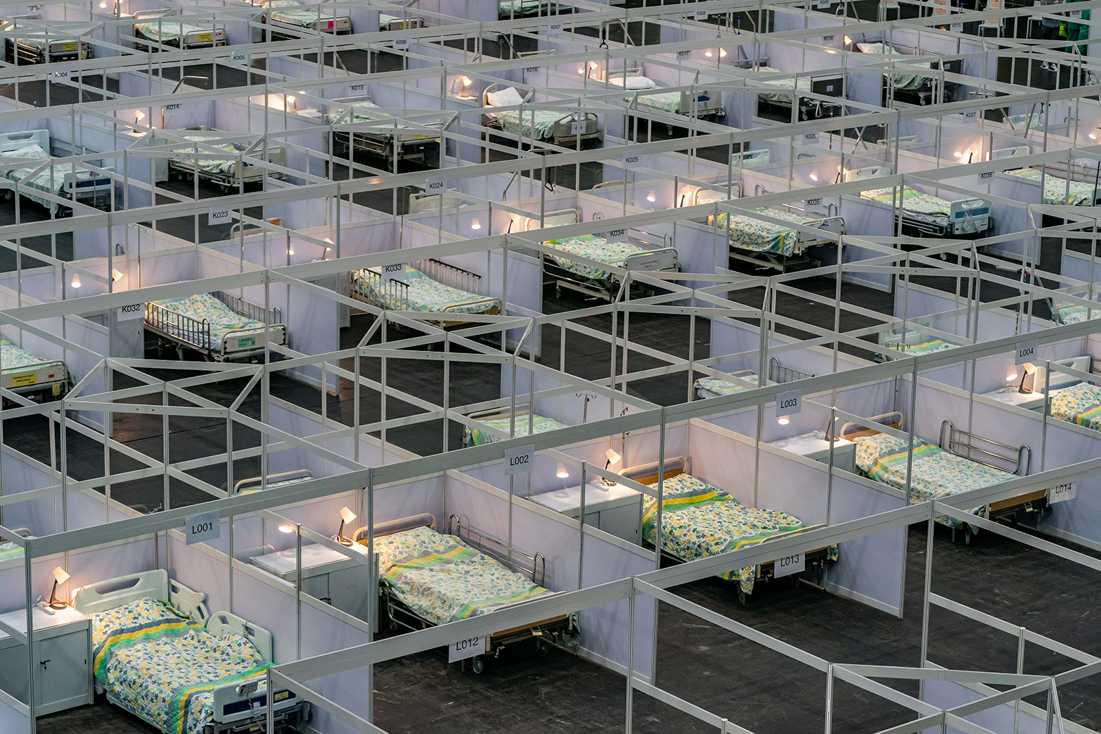 Beds are seen at a temporary field hospital set up at Asia World Expo in Hong Kong, China on August 1. AsiaWorld-Expo has been converted into a makeshift hospital that can take up to 500 patients.