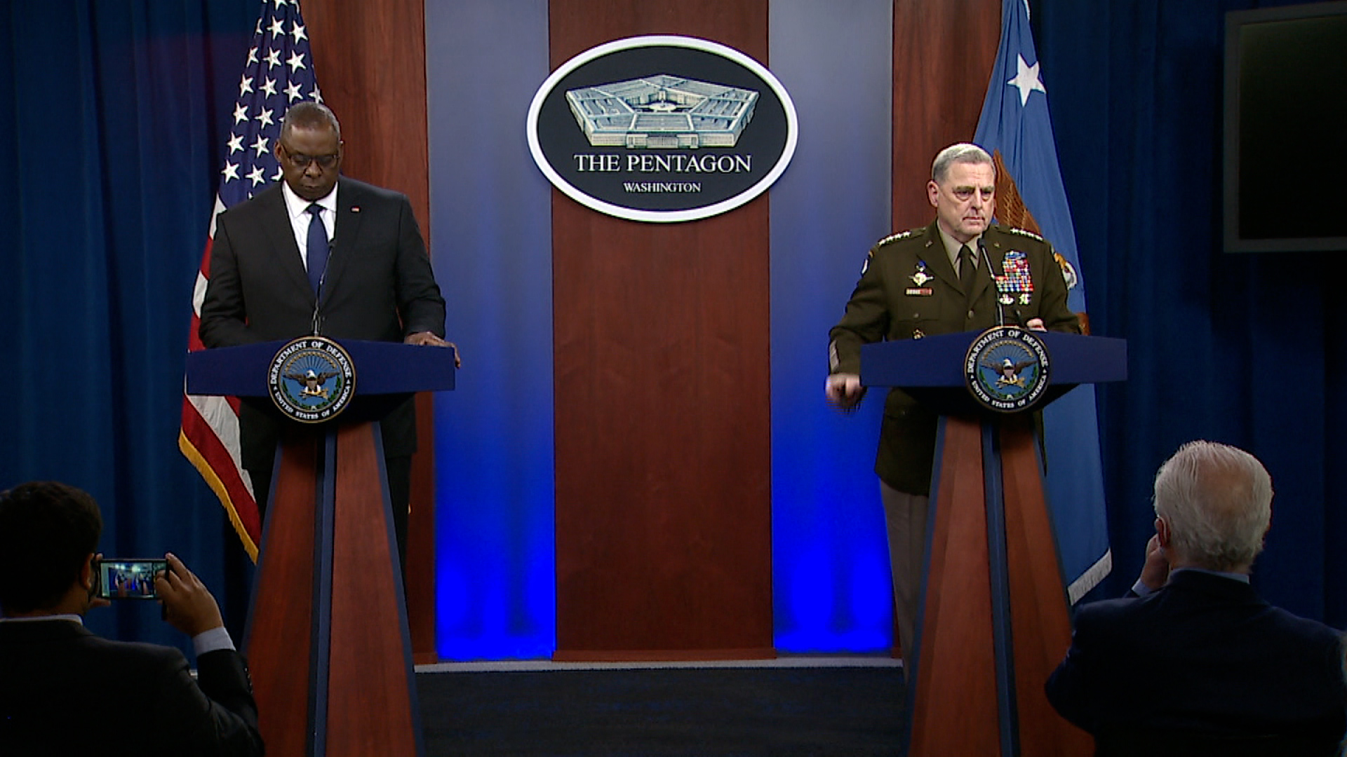 Secretary of Defense LloydAustin, left,and Chairman of the Joint Chiefs of Staff Gen. Mark Milley speak during a press briefing at the Pentagon in Washington, DC, on August 18.