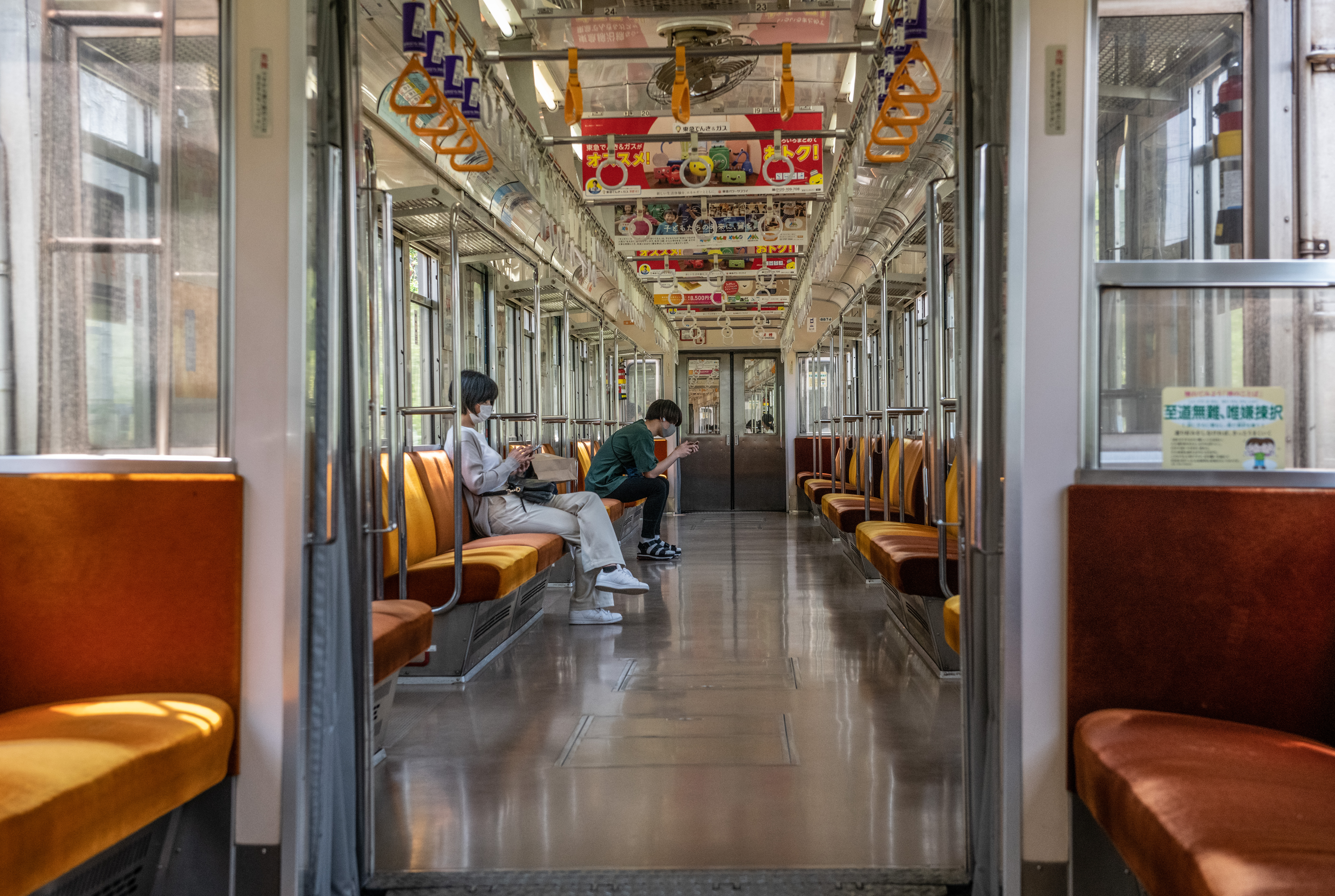 People ride an almost empty Tokyu Den-en-toshi Line train during the first weekend of the Golden Week national holiday on May 2, in Tokyo.