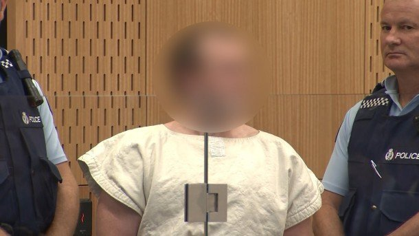 Brenton Tarrant appears in court in Christchurch. His face is blurred due to court restrictions on the case.
