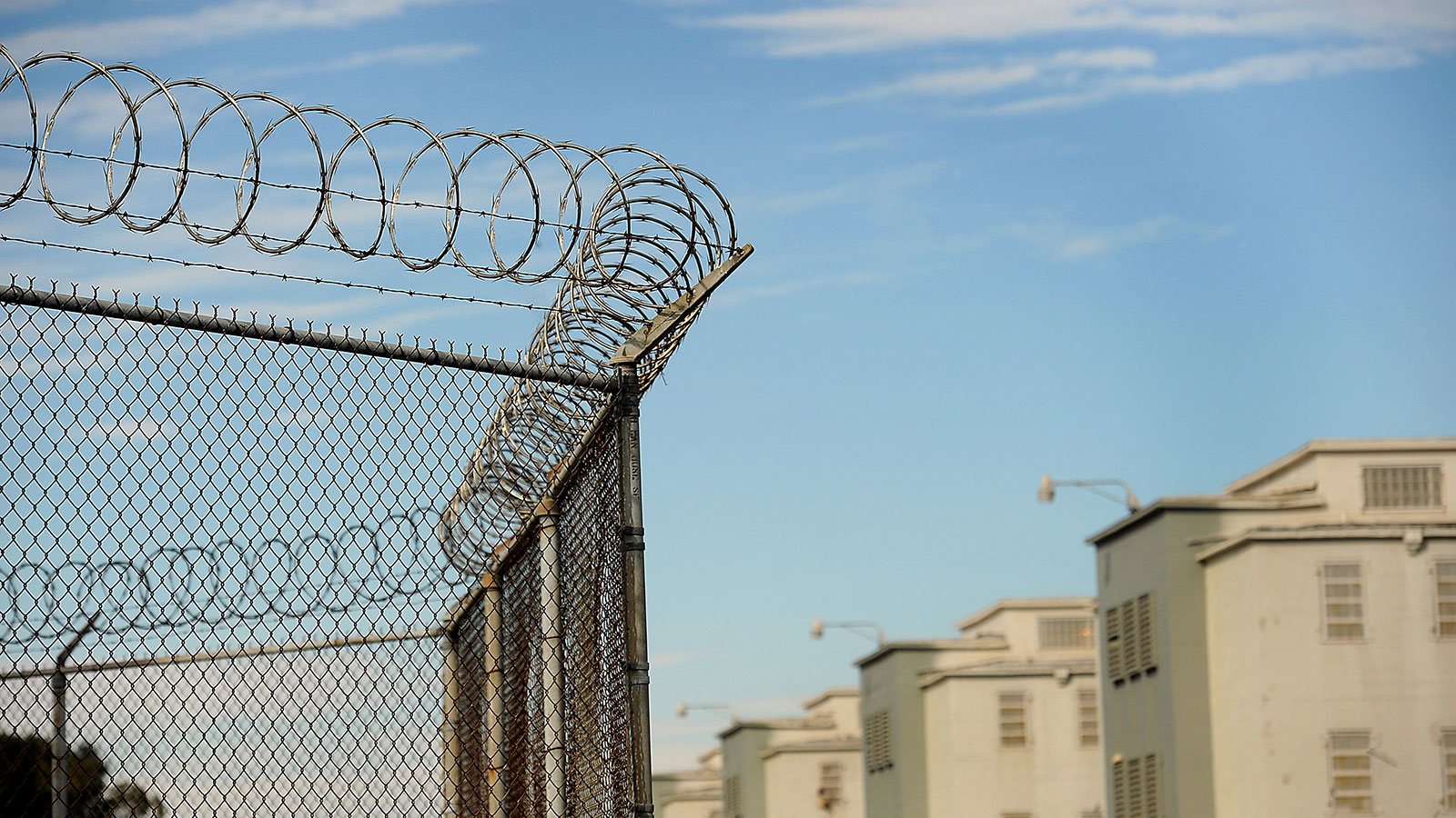 In this 2011 file photo, barbed wire marks the perimeter of a California Department of Corrections and Rehabilitation facility in Tracy, California.