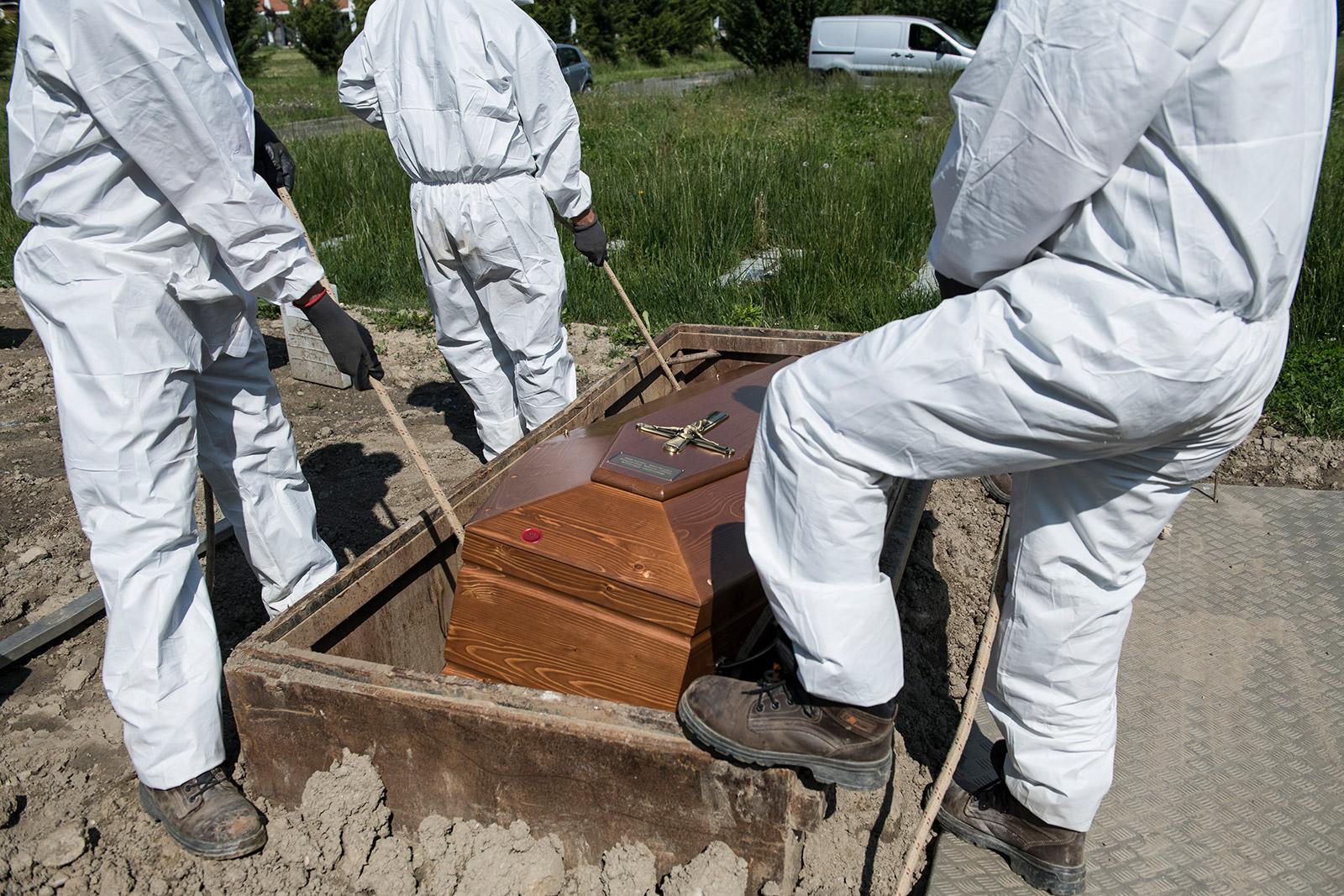 Cemetery workers bury a coronavirus victim in Turin, Italy, on May 6.