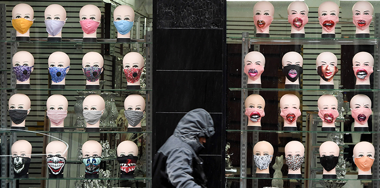 A member of the public walks past a shop selling face masks Glasgow on September 2.