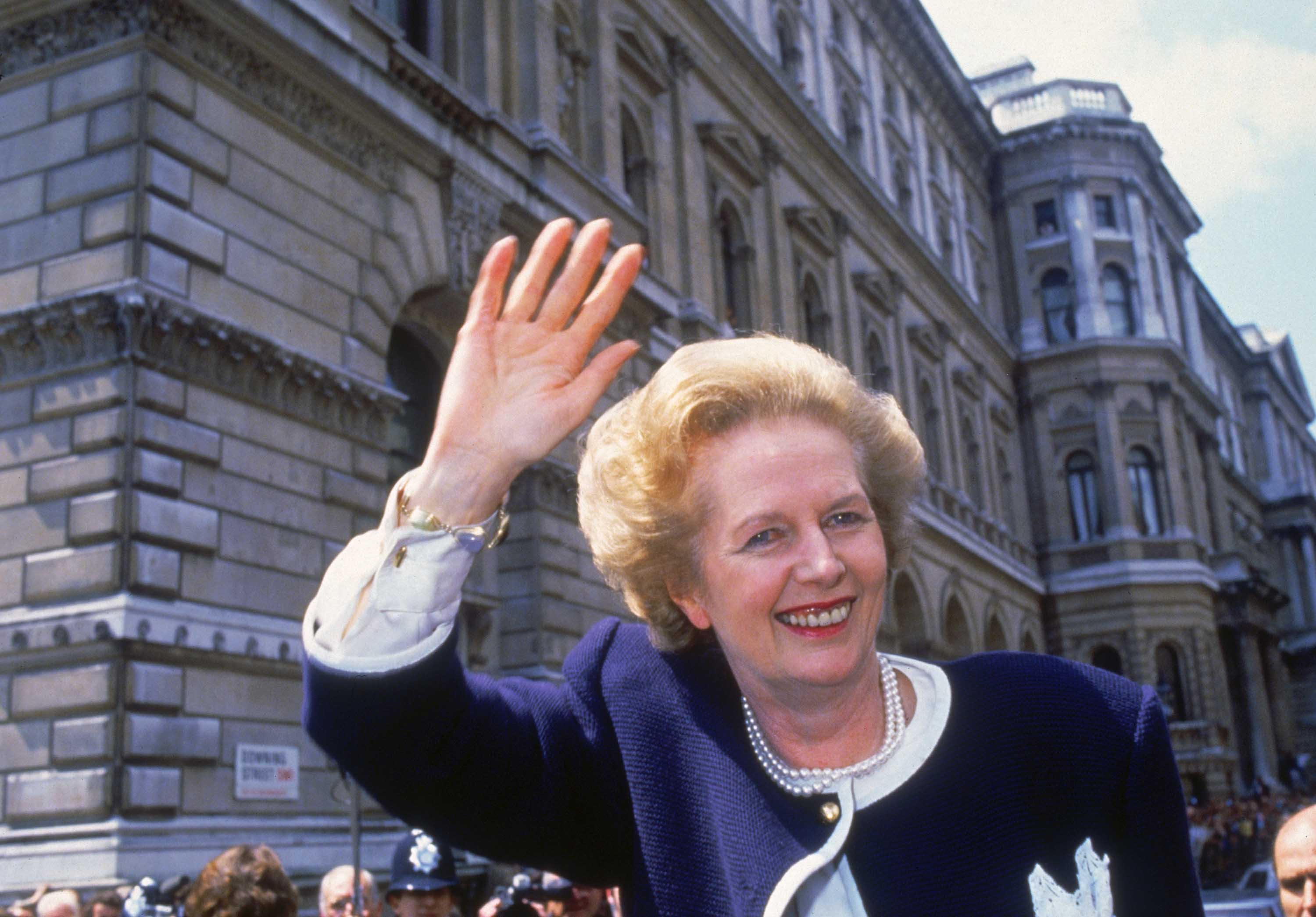 British Prime Minister Margaret Thatcher waves outside 10 Downing Street in London on election day, June 11, 1987. The vote resulted in the third consecutive victory for Thatcher's Conservative Party. Photo: Fox Photos/Hulton Archive/Getty Images