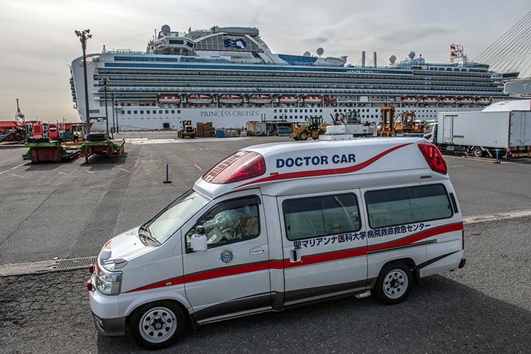 Medical staff wait outside of the Diamond Princess cruise ship at Daikoku Pier in Yokohama, Japan, on February 7.
