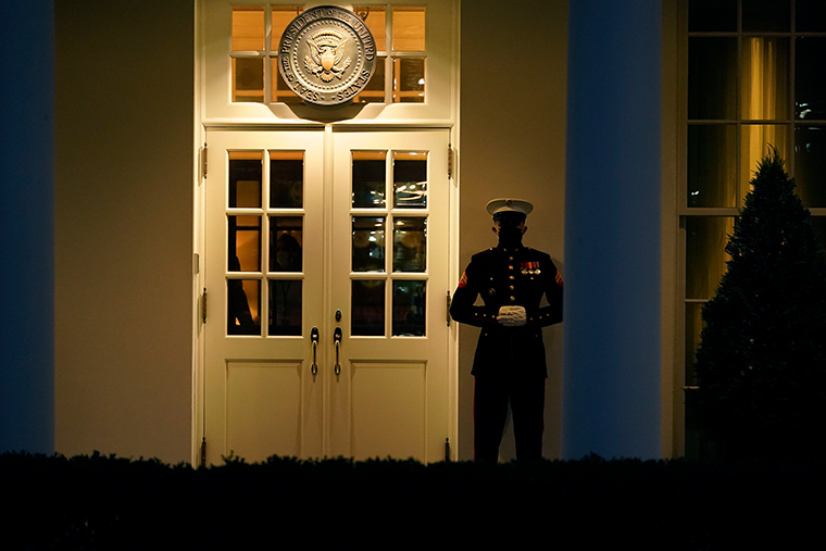 A Marine guard stands at the entrance to the West Wing of the White House on Wednesday, Jan. 13, 2021.