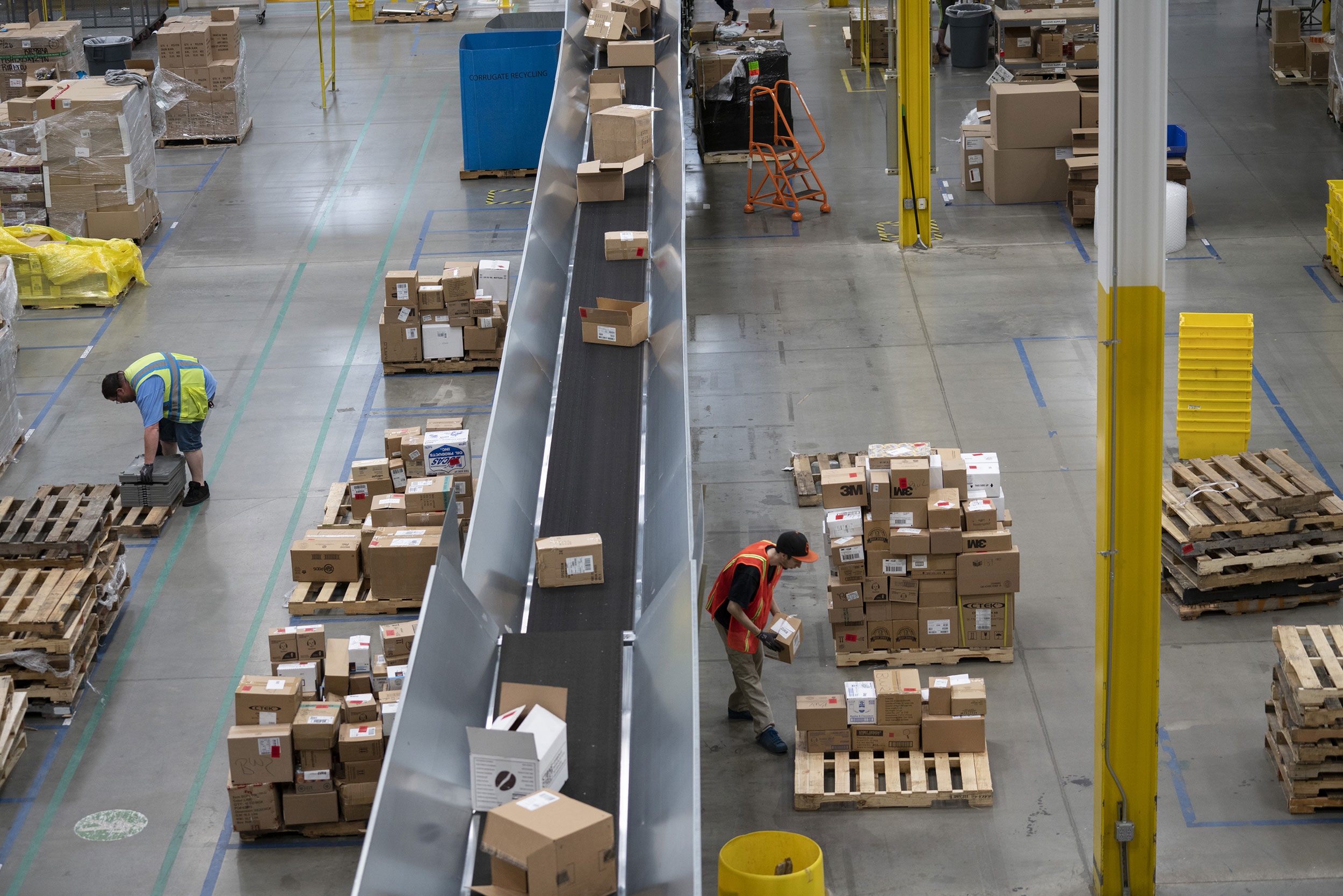 Employees work at the Amazon fulfillment center in Baltimore, Maryland.