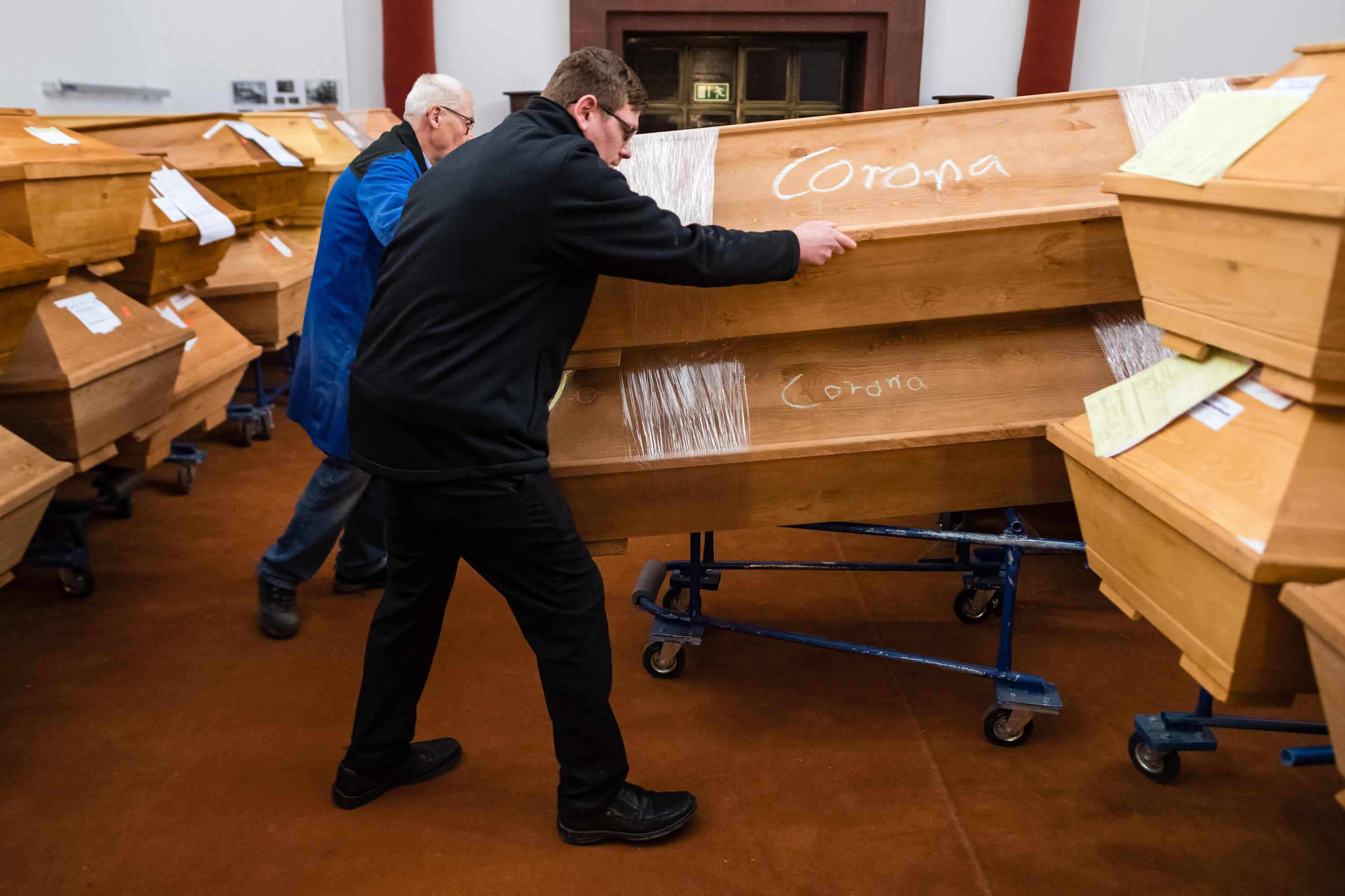 A worker moves a coffin at a crematorium in Meissen, Germany, on January 13.