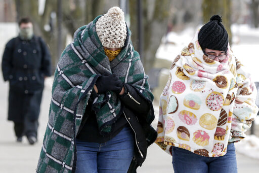Pedestrians bundle up in sub-freezing temperatures on the campus of the University of Nebraska-Omaha on Wednesday.