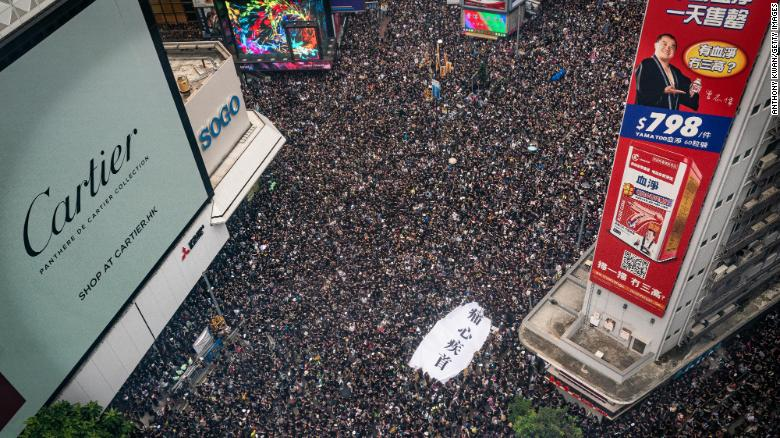 Protesters perform the streets of Hong Kong on Sunday.