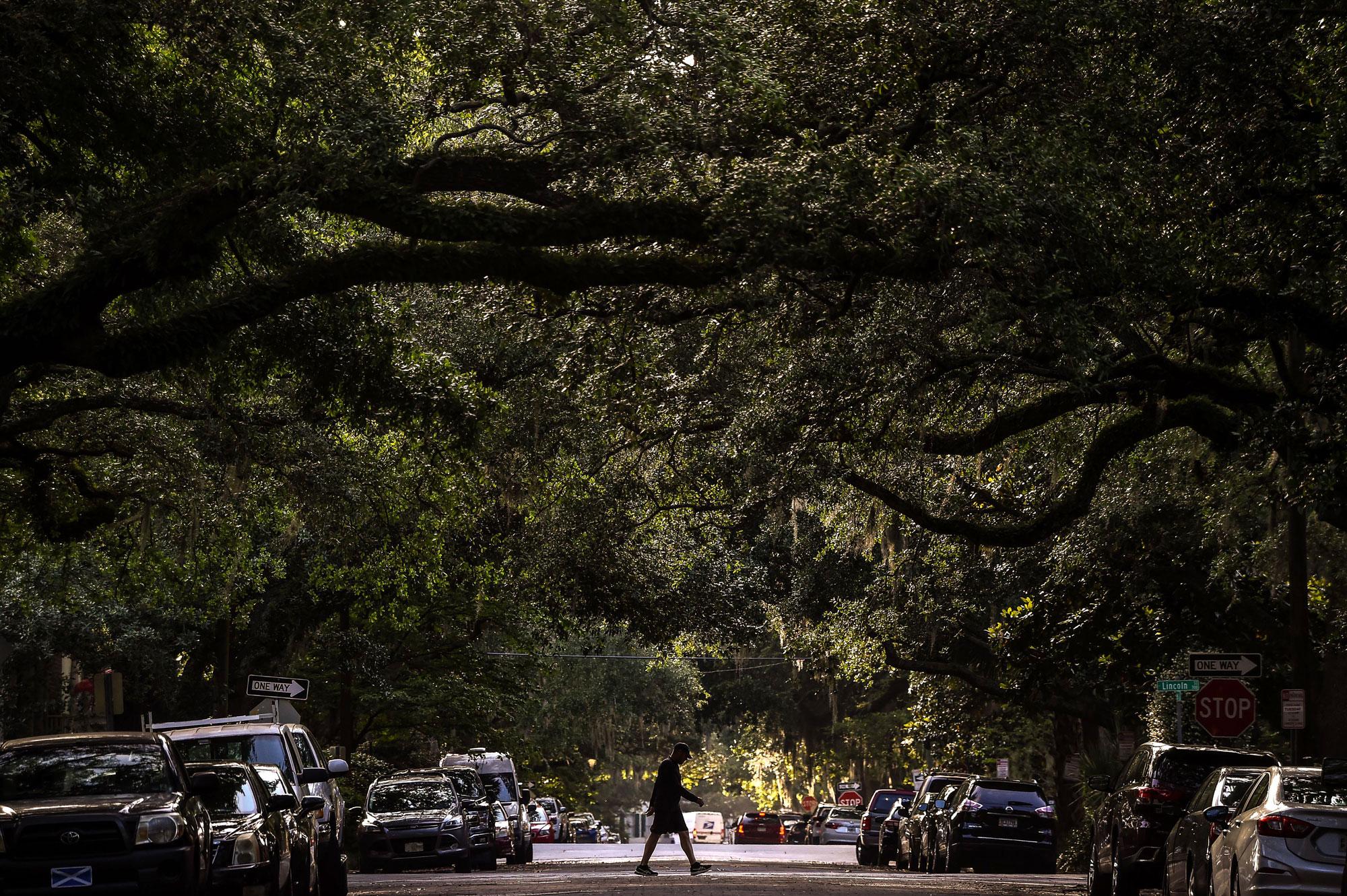 A man walks in the Historic District in Savannah, Georgia, on April 25.
