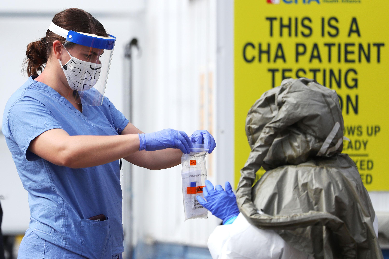 Medical professionals work at a drive-thru coronavirus testing site on May 15 in Cambridge, Massachusetts.