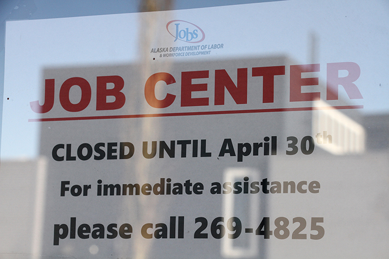 A sign saying that the Jobs Center at the Alaska Department of Labor and Workforce Development office in midtown Anchorage, Alaska, is closed through the end of April is shown Monday, March 30.