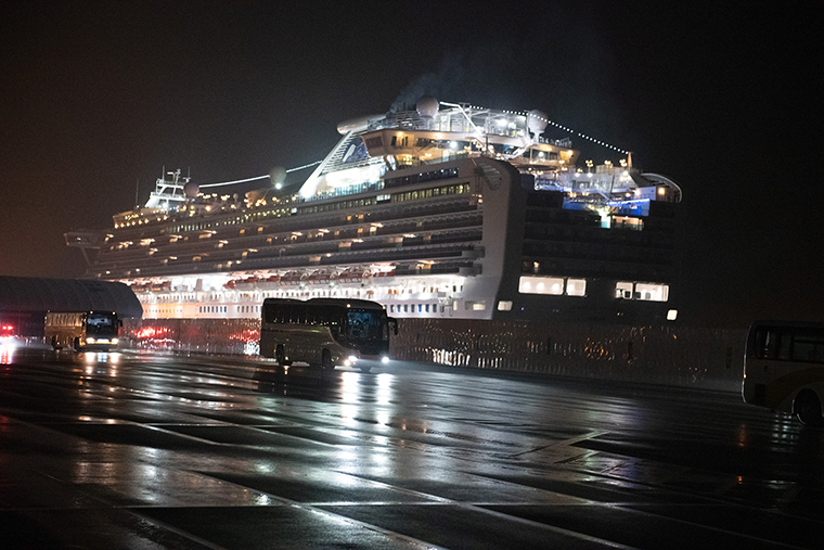 Buses carry American citizens from the quarantined Diamond Princess cruise ship at Daikoku Pier to be repatriated to the United States, on Monday, February 17 in Yokohama, Japan.