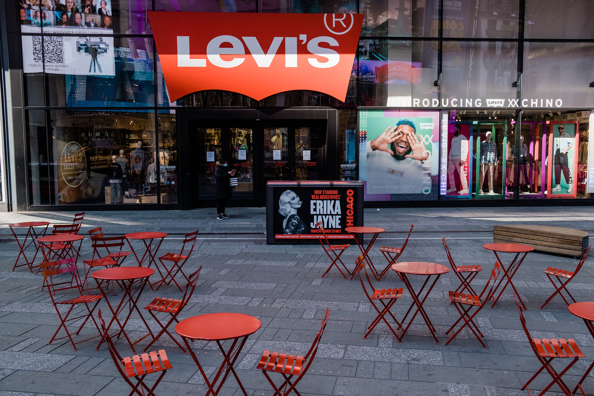 Empty tables are seen in Times Square on Monday, March 16.