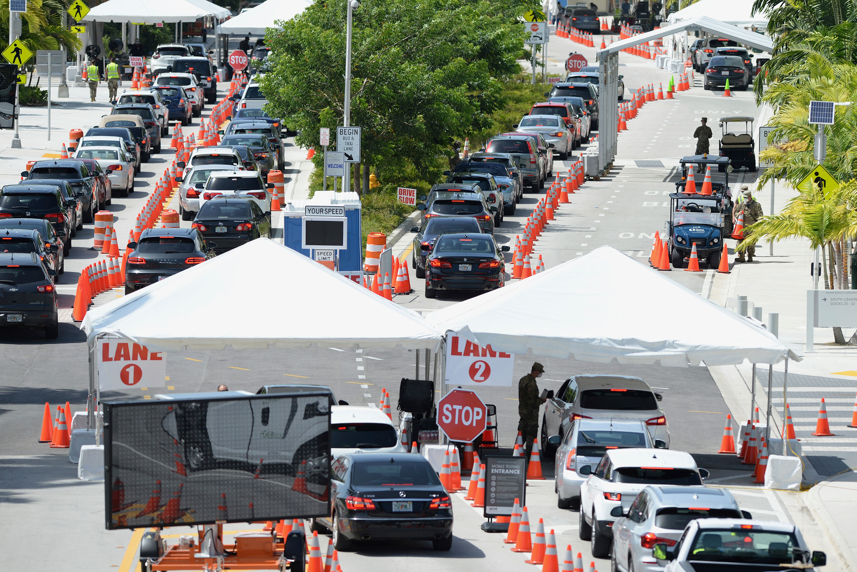 Cars wait in line at a drive-thru coronavirus testing site on July 2 in Miami Beach, Florida.