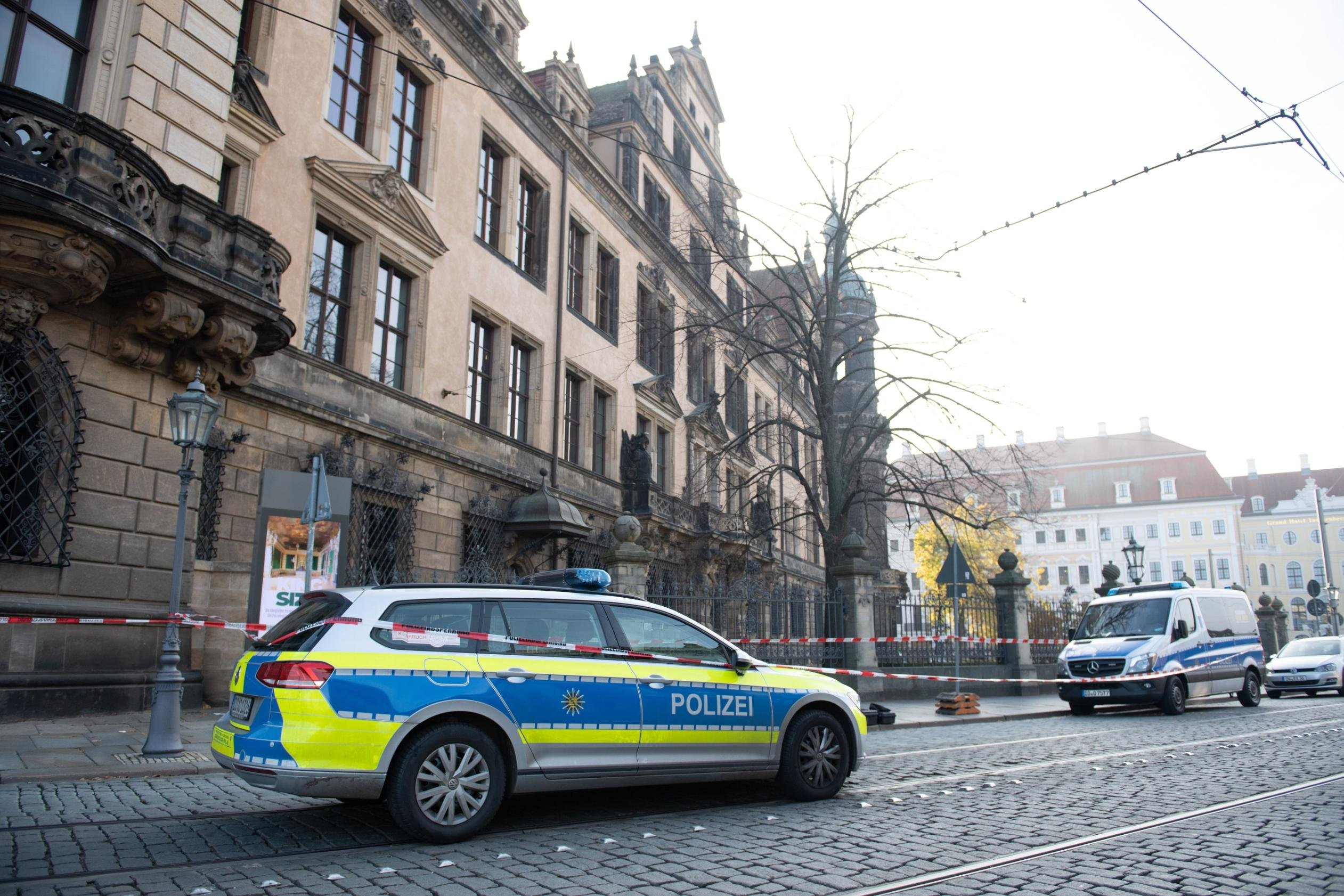 A police car is seen in front of the Royal Palace that houses the historic Green Vault in Dresden.