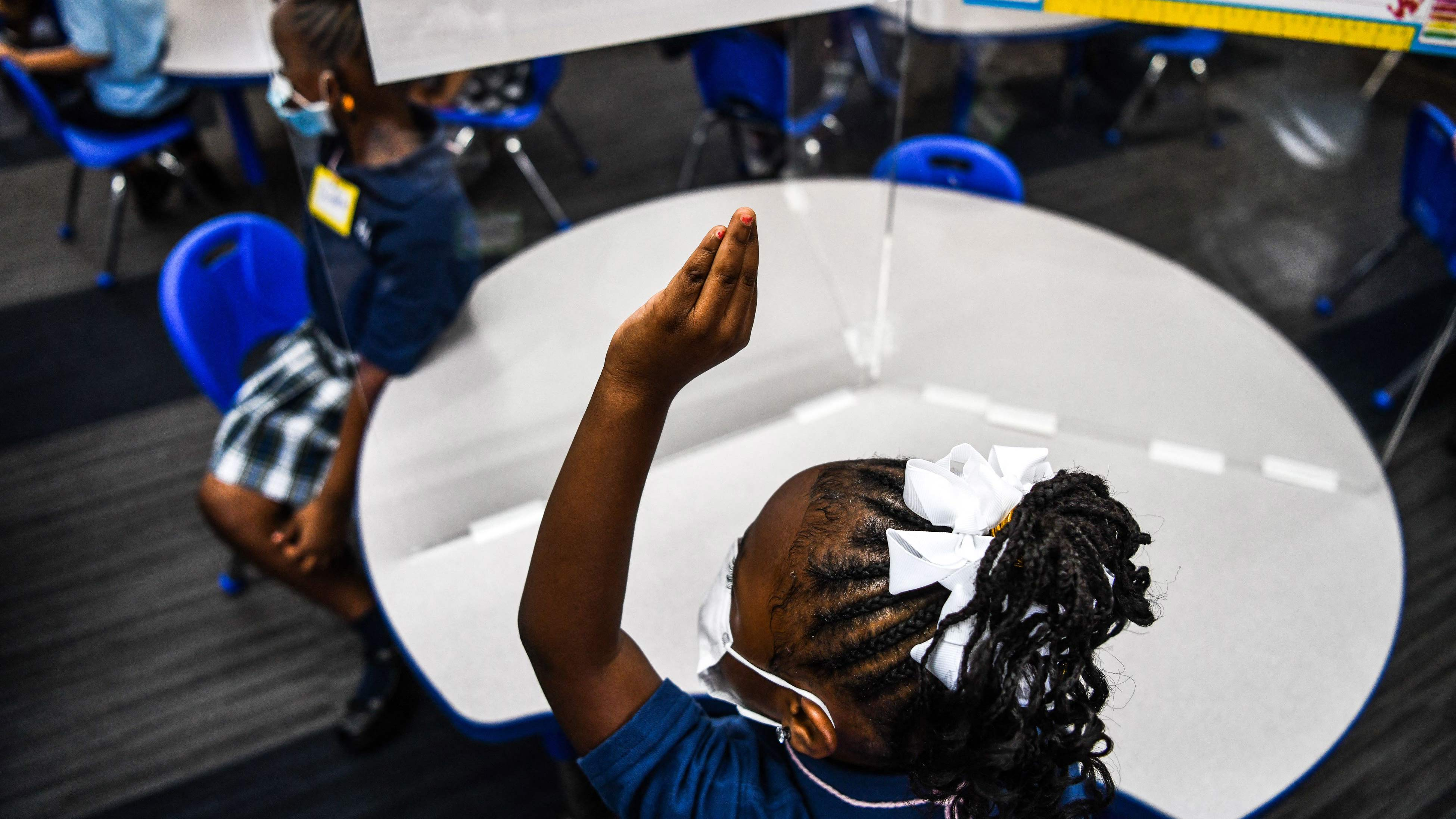 Students attend their first day of school after summer vacation at the St. Lawrence Catholic Schoolin Miami on August 18.