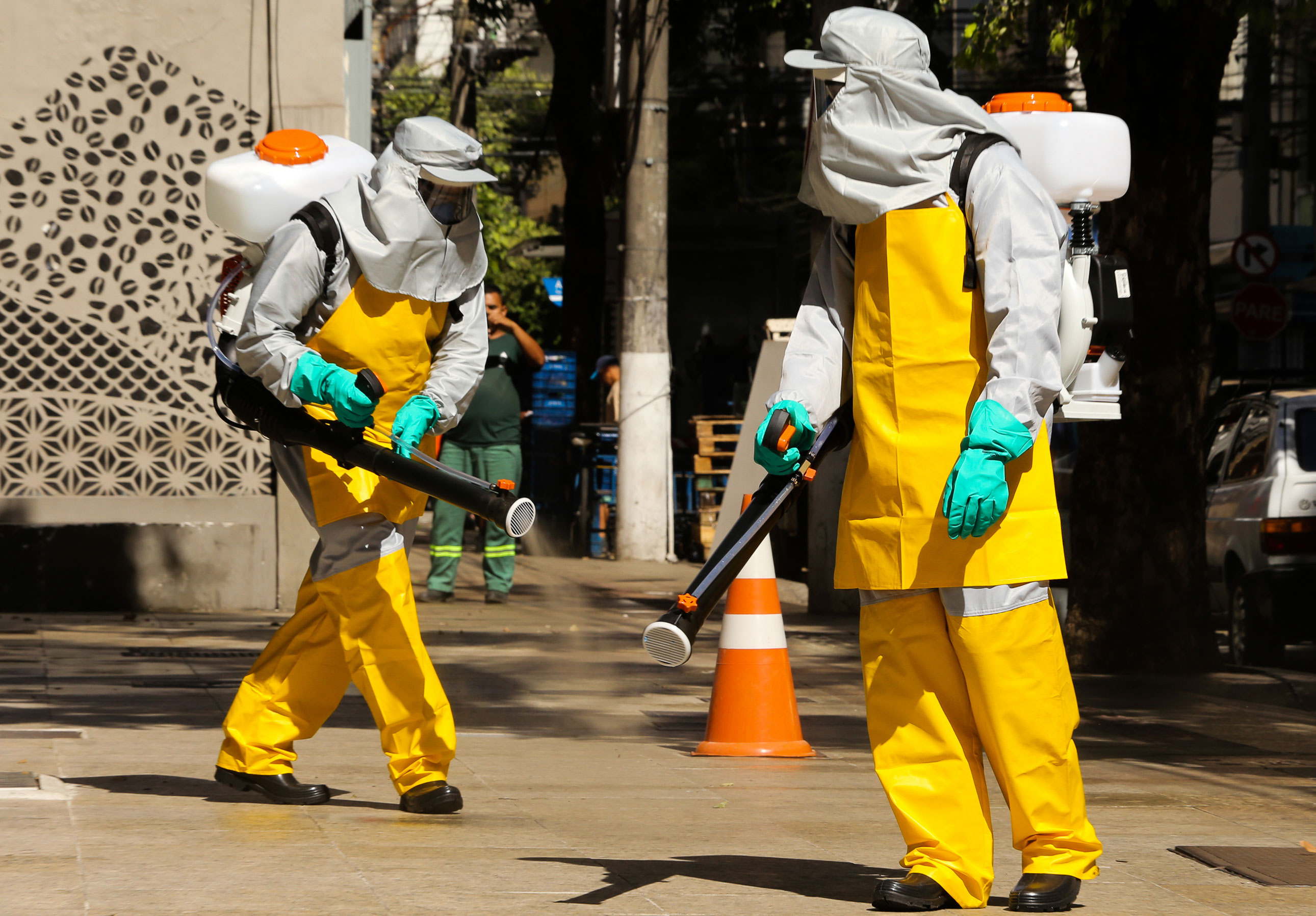 Members of a cleaning crew disinfect a neighborhood in Niteroi, Brazil on March 23.