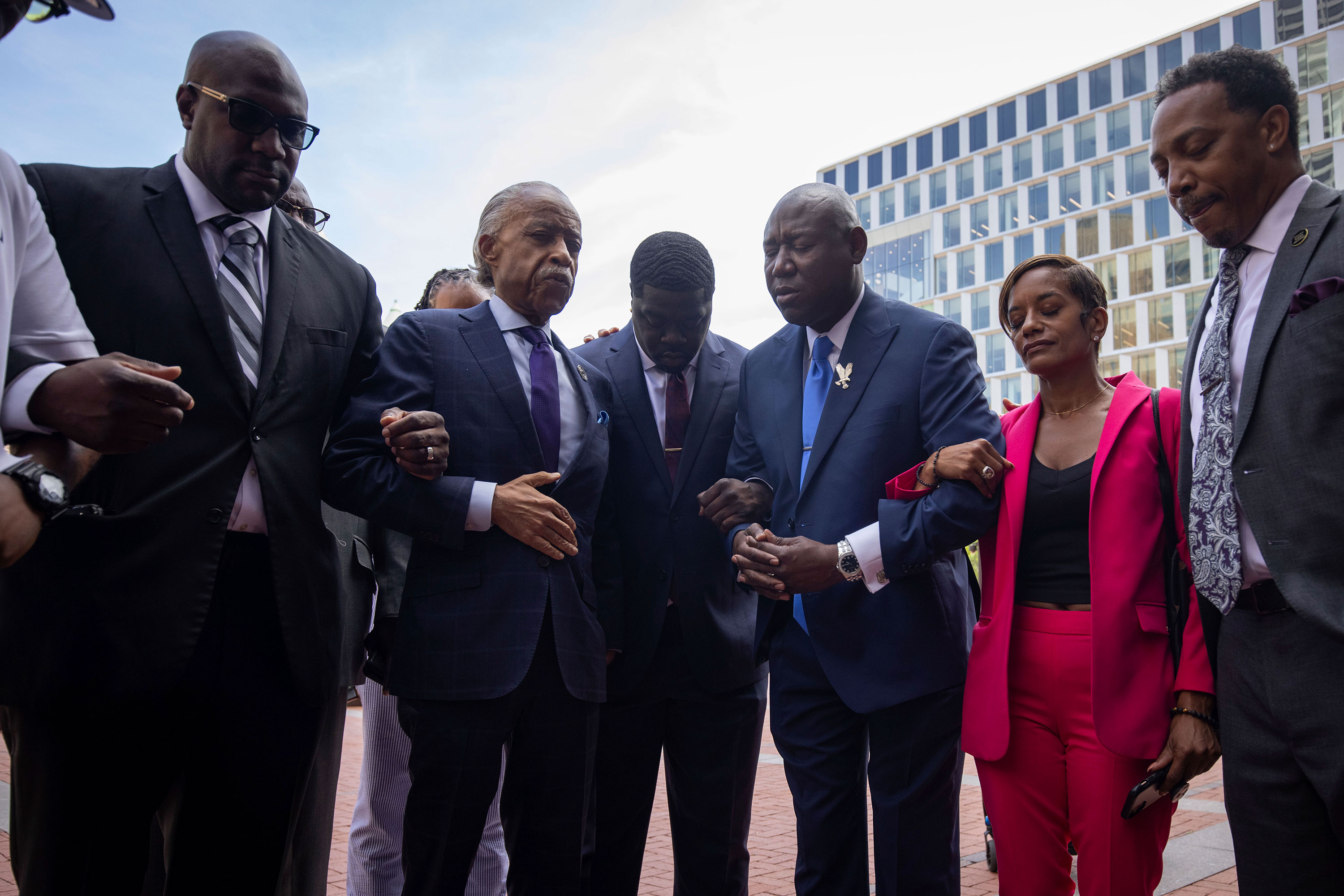 Rev. Al Sharpton and attorney Ben Crump hold a prayer with members of George Floyd's family outside of the Hennepin County Government Center in Minneapolis.