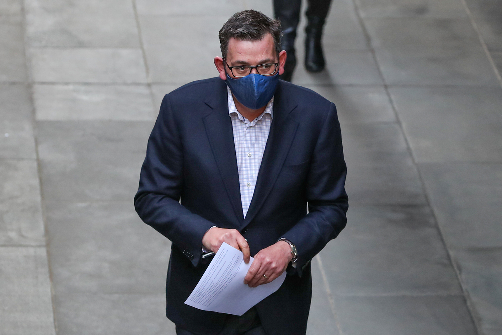 Premier Daniel Andrews wearing a mask arrives for a press conference in Melbourne, Australia  on July 24.