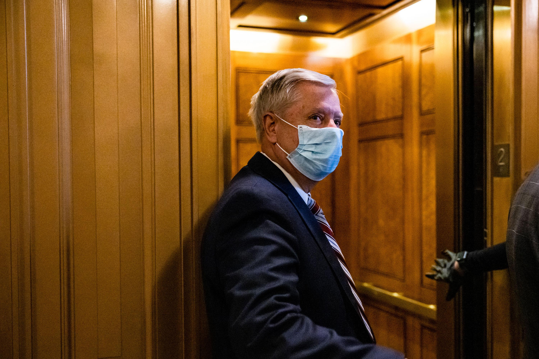 Sen. Lindsey Graham leaves the floor of the Senate on January 26.
