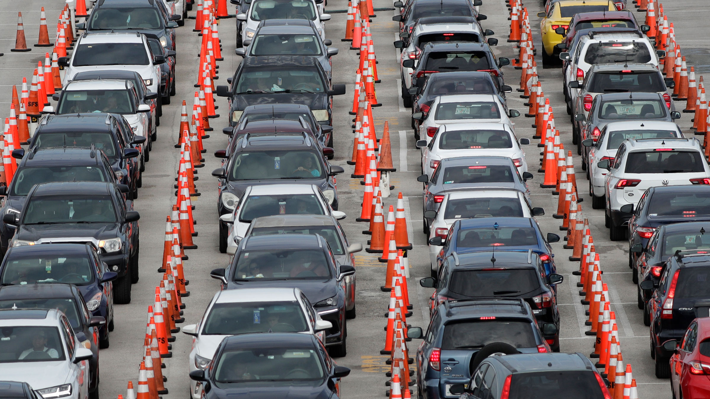 Lines of cars wait for coronavirus testing at a drive-through site in Miami Gardens, Florida, on July 5.