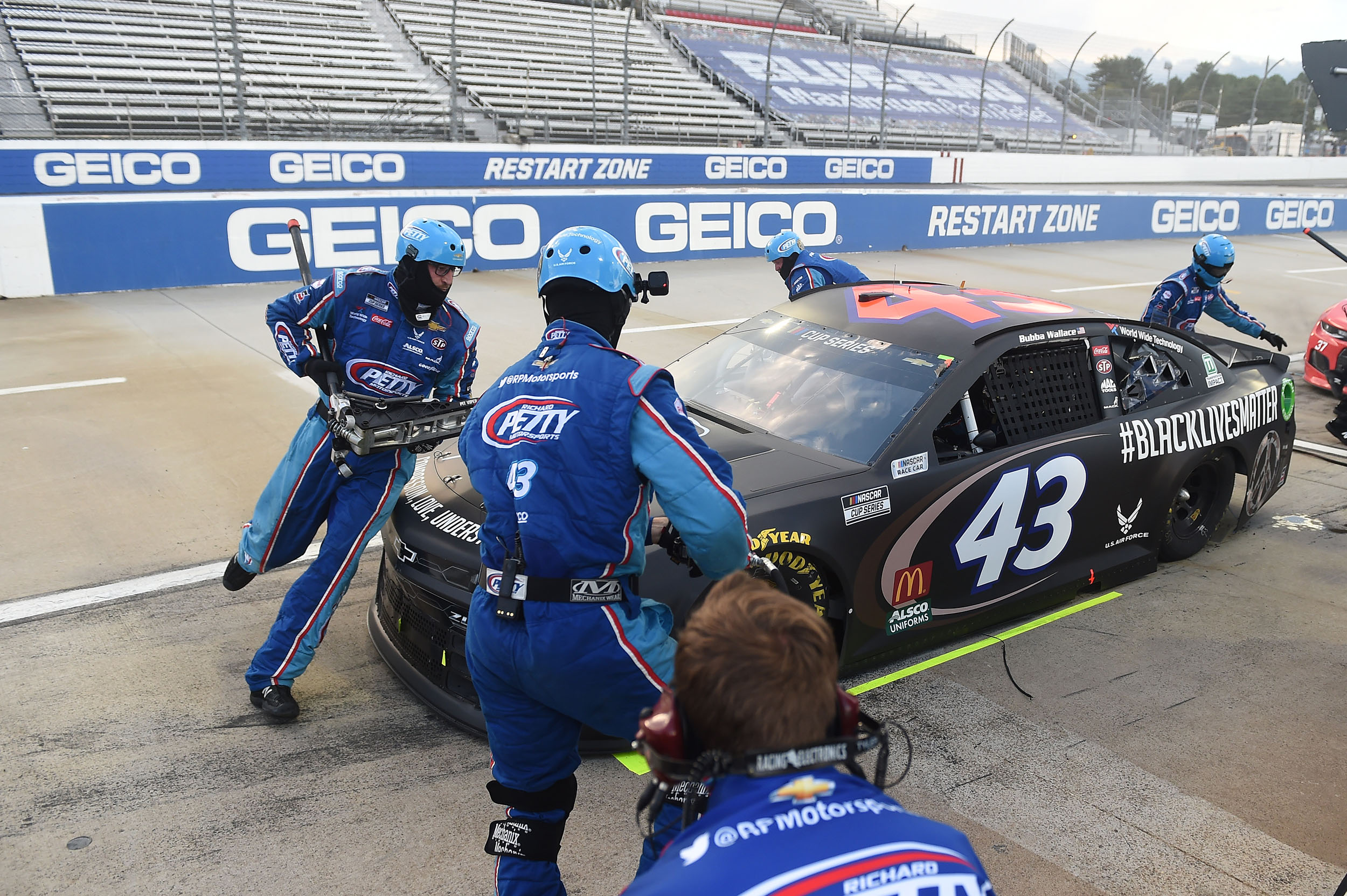 Bubba Wallace, pits during the NASCAR Cup Series Blue-Emu Maximum Pain Relief 500 at Martinsville Speedway on June 10, in Martinsville, Virginia.