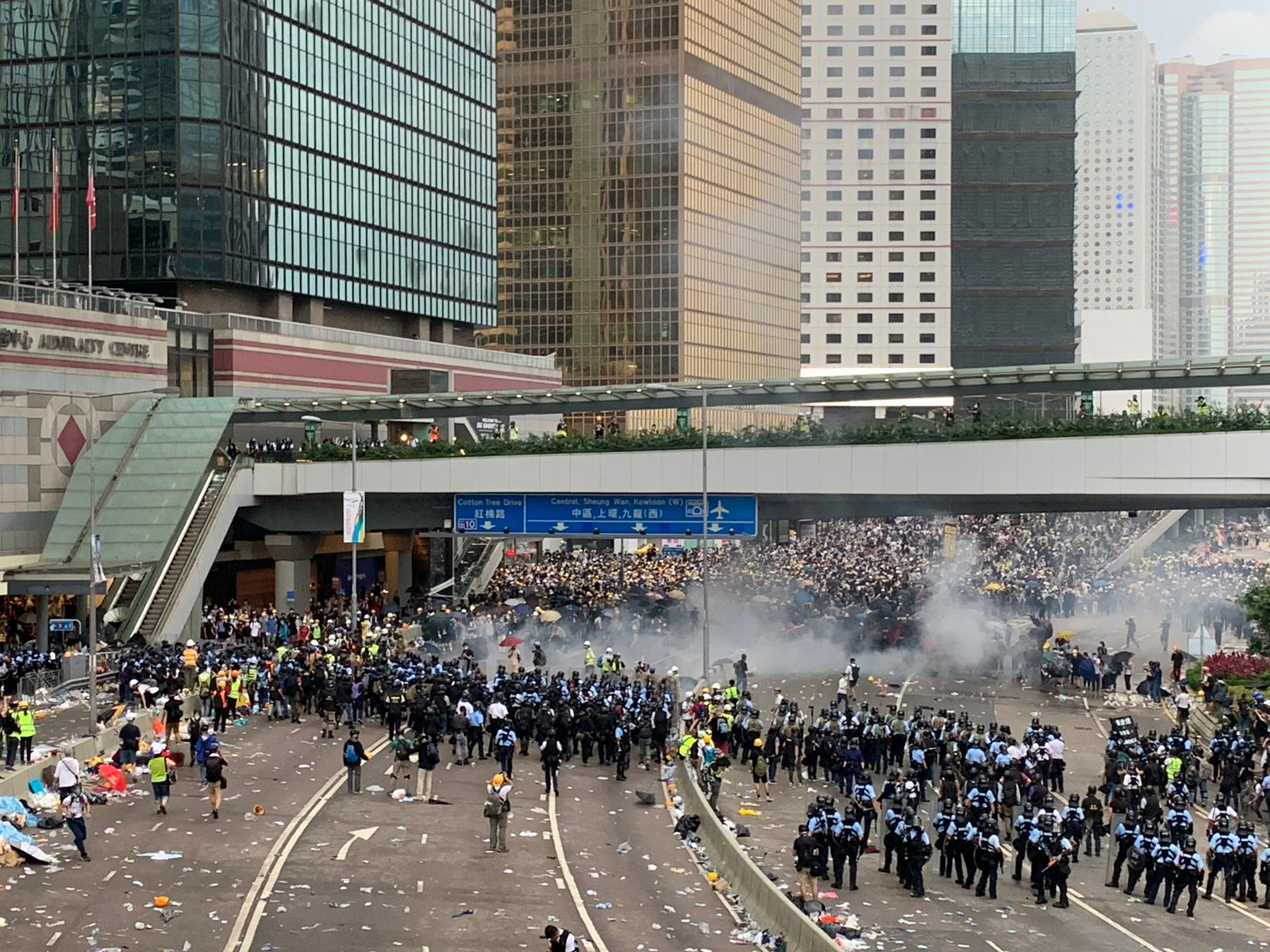 Protesters being physically expelled from Harcourt Road by police on Wednesday using tear gas and riot gear.