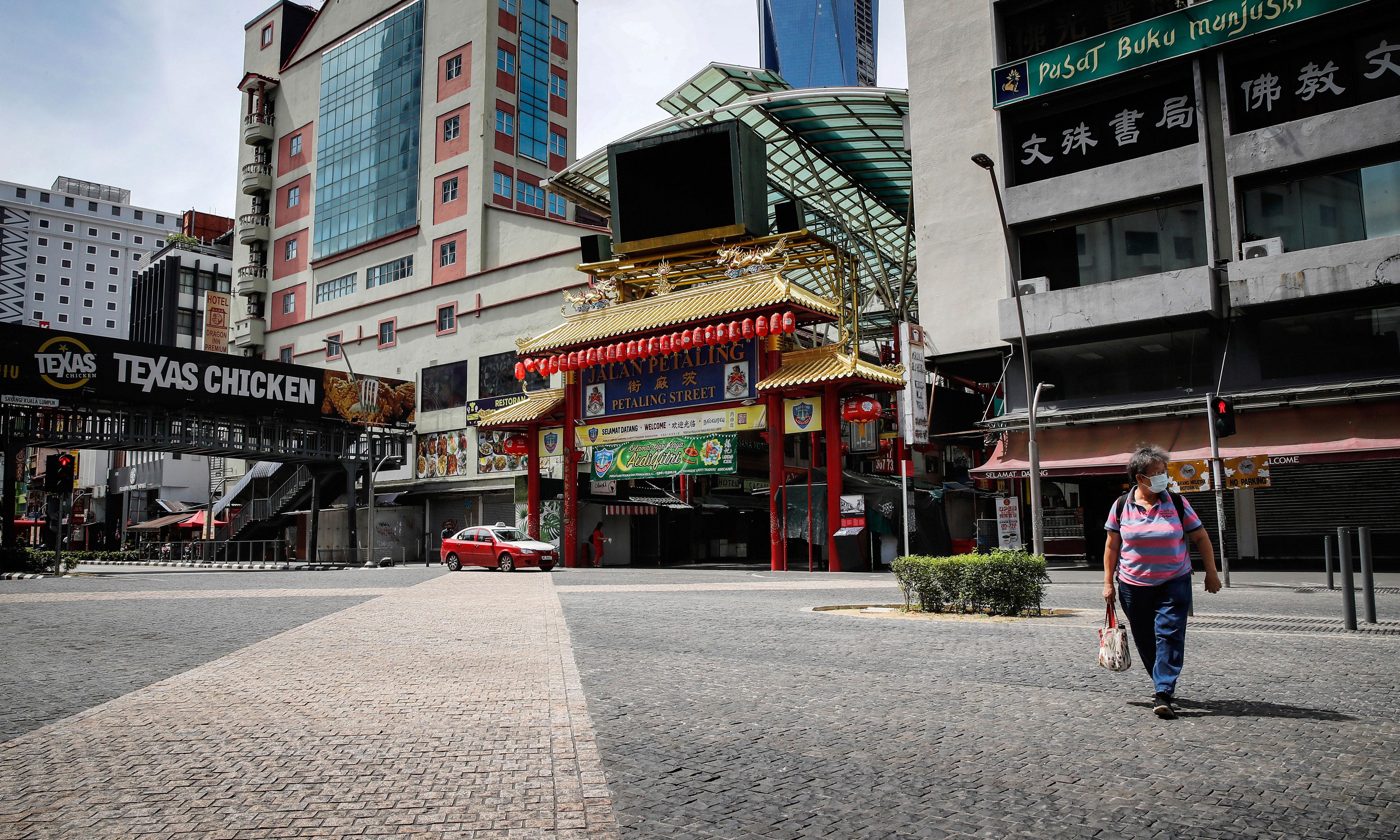A road near Chinatown in Kuala Lumpur, Malaysia, is near-empty on May 7.