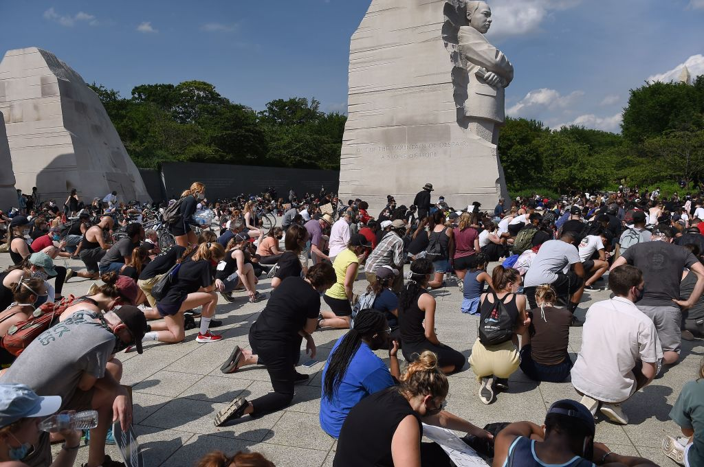 Demonstrators kneel down at The Martin Luther King Jr. Memorial as they protest the death of George Floyd in Washington, DC, on June 4.
