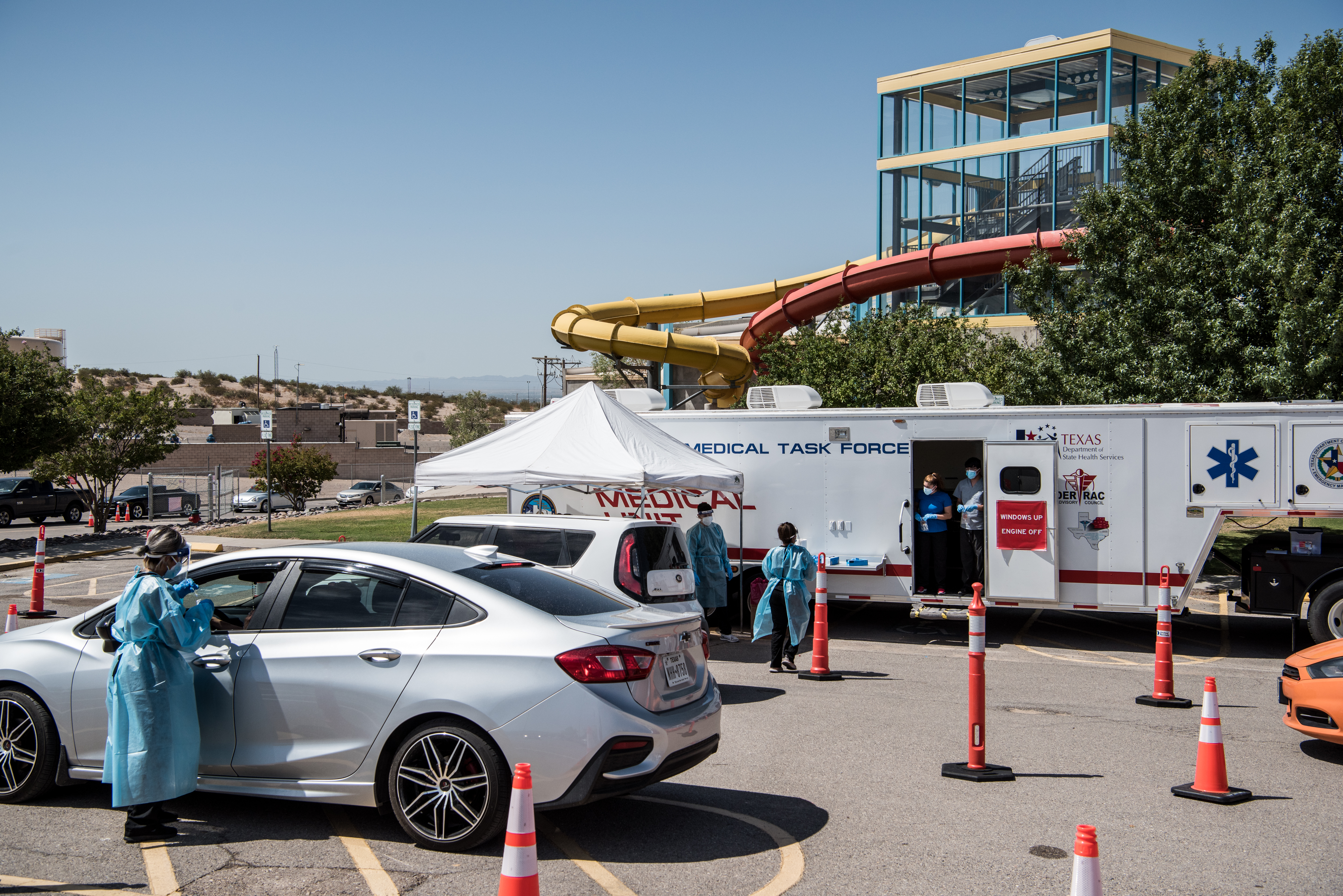 Nurses work on July 21 at a drive-thru Covid-19 testing site in El Paso, Texas.
