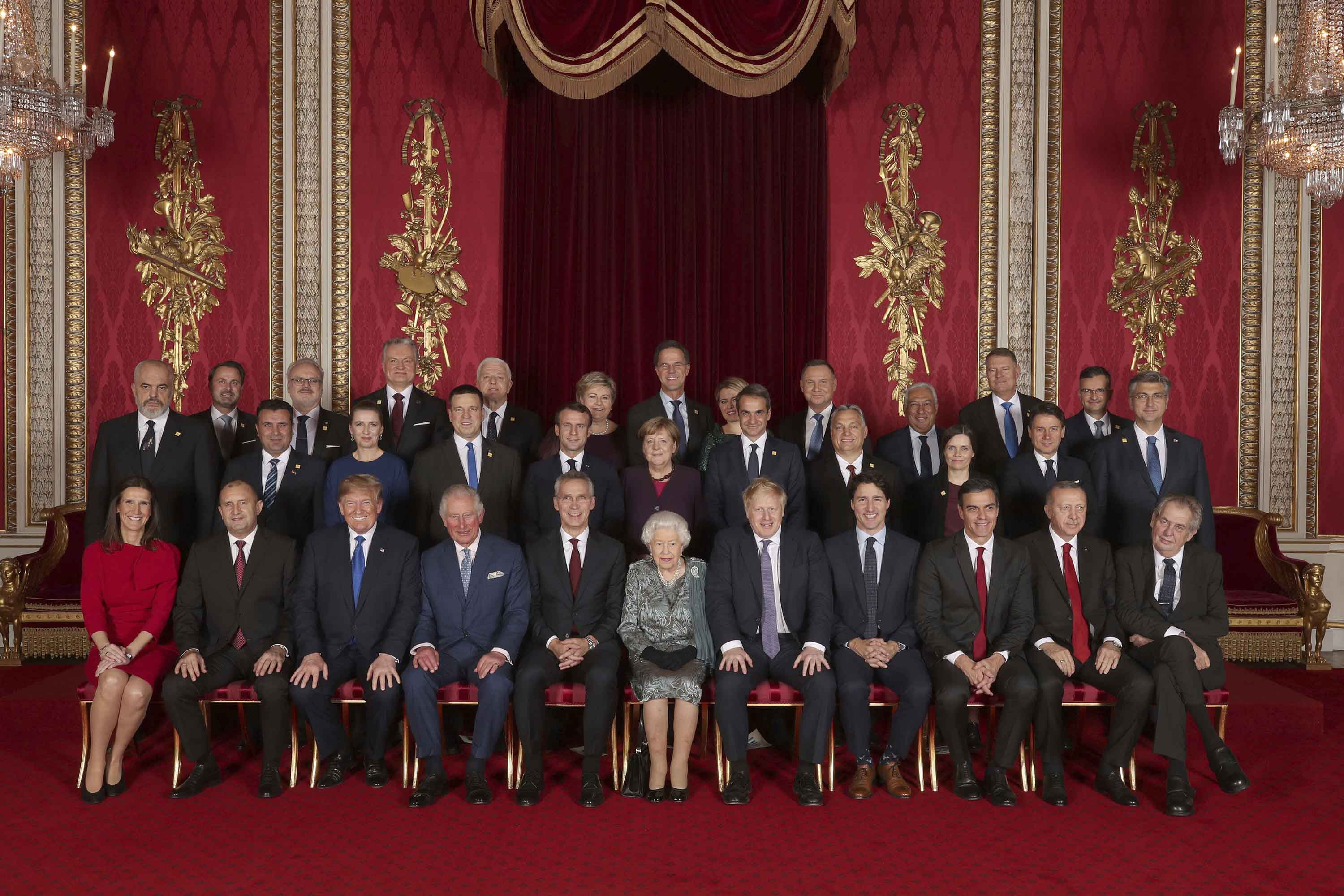 Leaders of the NATO alliance countries, and its secretary general, join Queen Elizabeth II and Prince Charles the Prince of Wales, for a group picture during a reception at Buckingham Palace in London on Tuesday. Photo: Yui Mok/Pool via AP